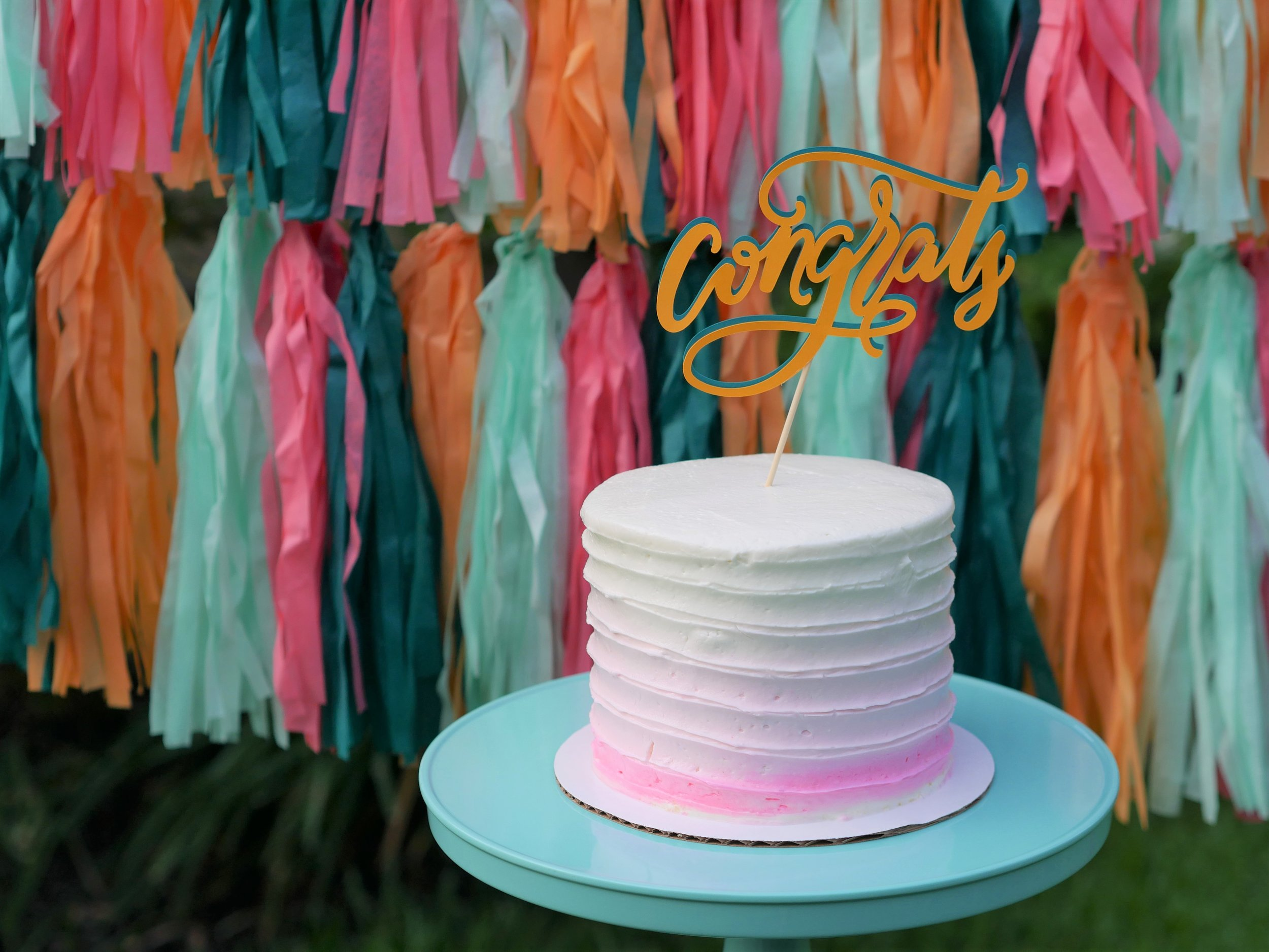 Tres Leches cake and a fun graduation fiesta in turquoise, coral, pinks and oranges. See more from this Modern Grad Party on Mint Event Design www.minteventdesign.com #graduationparty #graduationpartyideas #graduation #gradparty #gradpartyideas