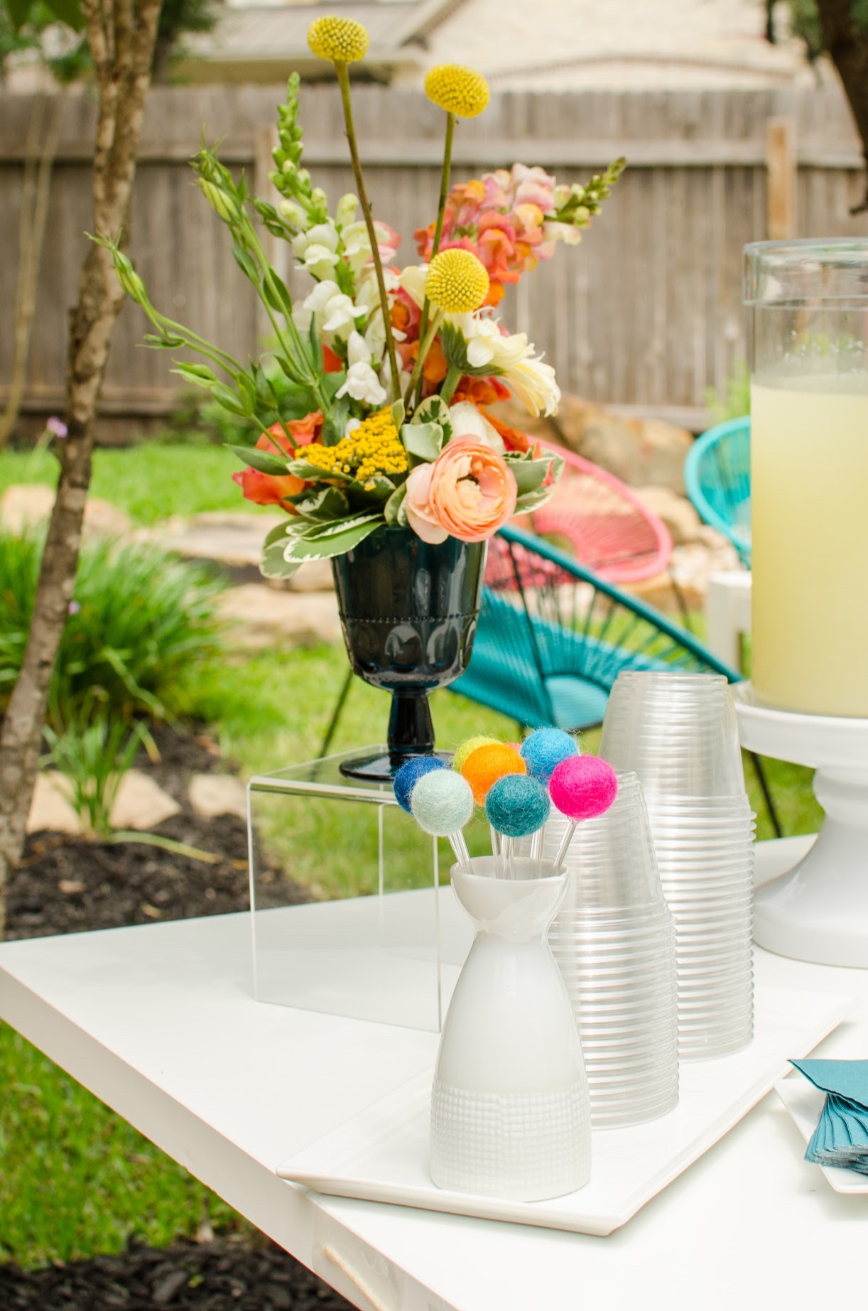 Floral summertime party ideas for a drink station. See more from this Grad Party on Mint Event Design www.minteventdesign.com