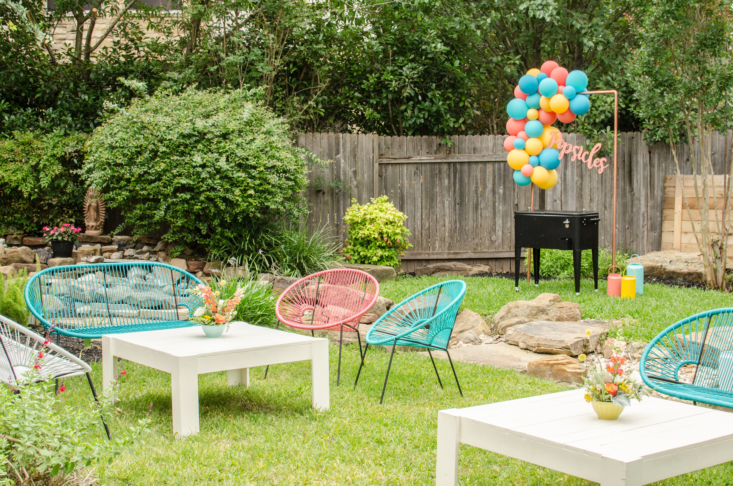 Outdoor Summer Party Lounge area with colorful chairs and loveseats is perfect for a teen graduation party. See more from this Grad Party on Mint Event Design www.minteventdesign.com