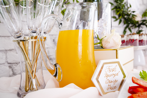 An elegant mimosa bar set up for a baby shower. As styled by Mint Event Design for Bento Picnic www.minteventdesign.com