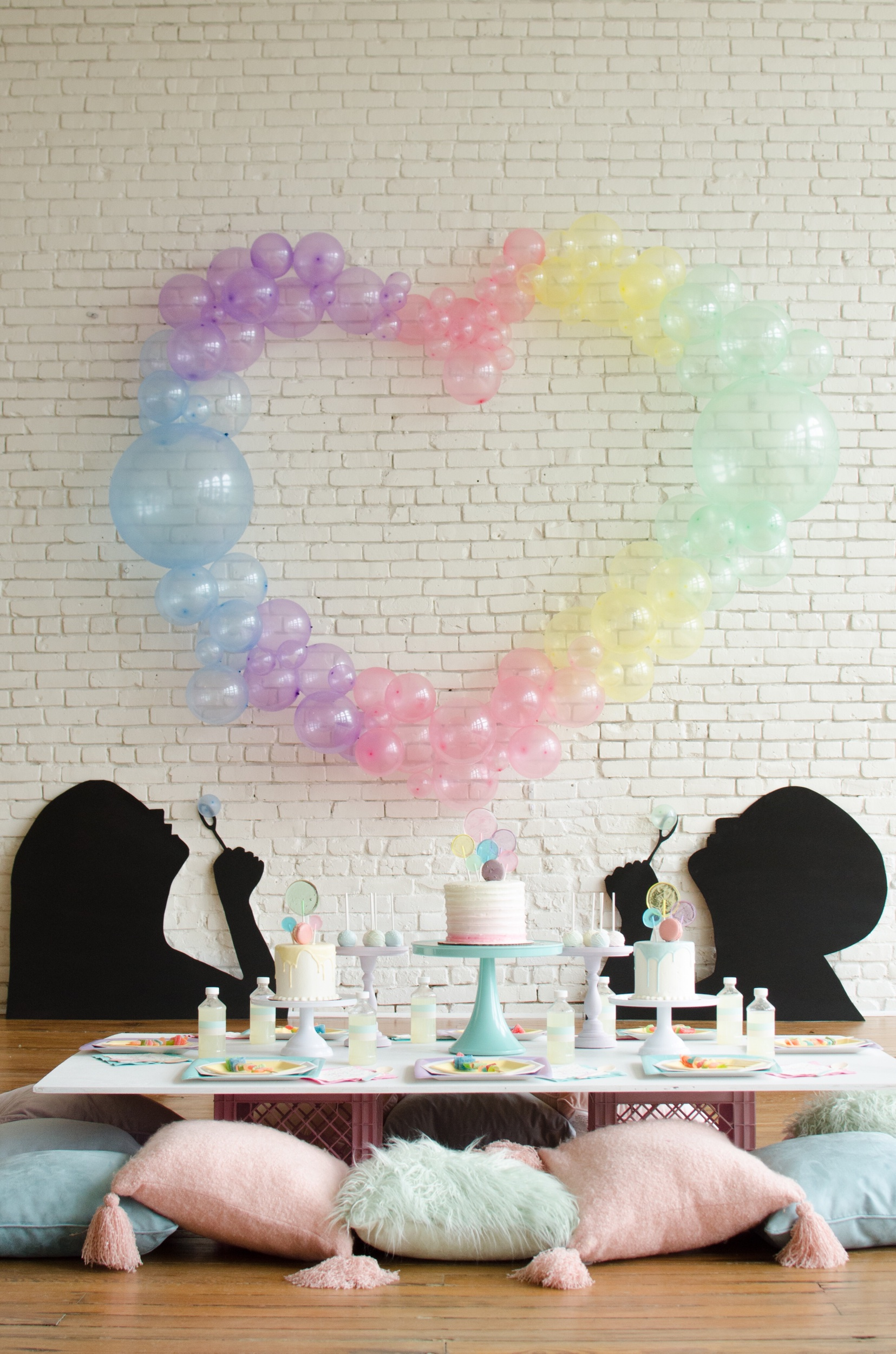 Balloon arch and bubble themed party