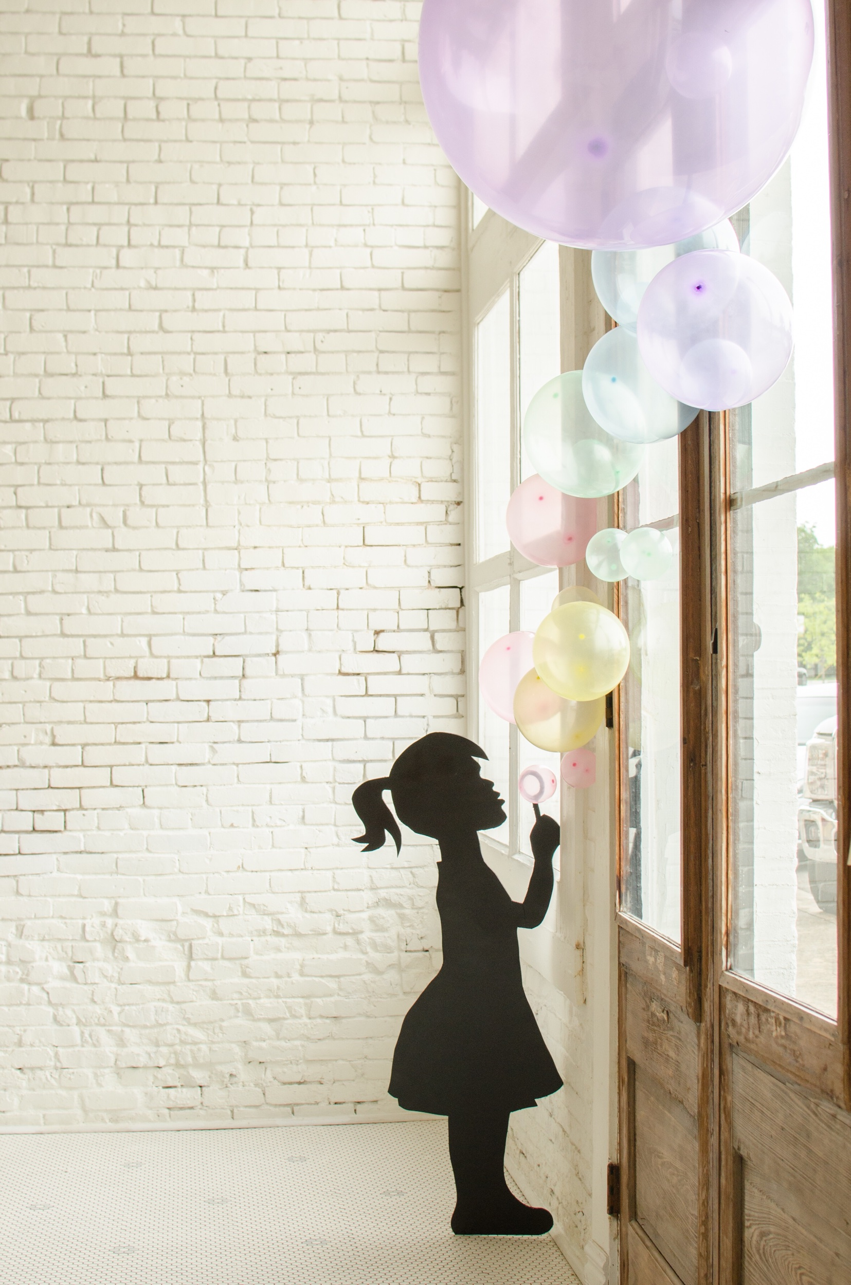 blowing bubbles silhouette at a bubble themed birthday party!