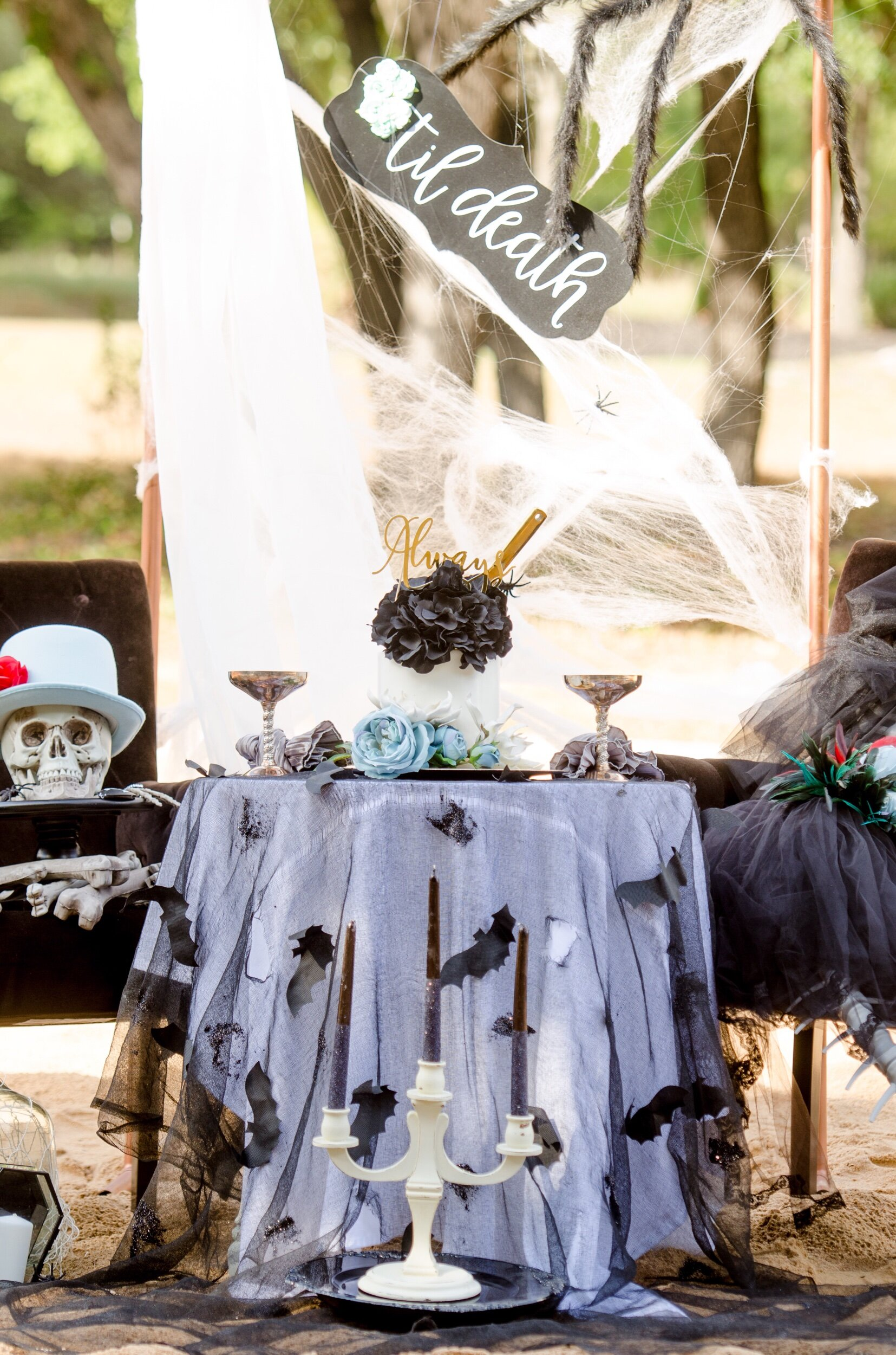 Halloween wedding cake table ideas from Mint Event Design - ripped gauze linen with bats and a candelabra