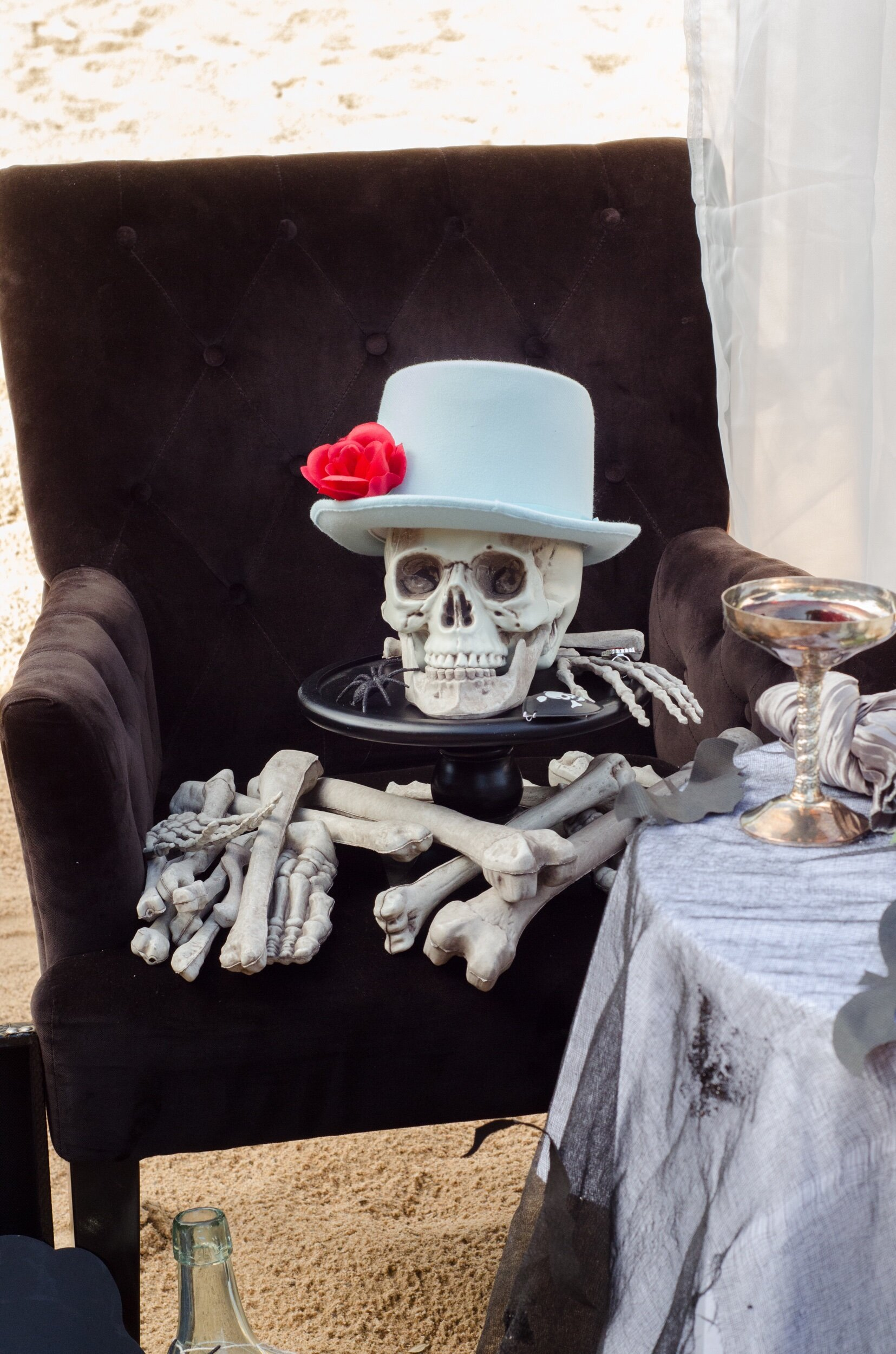 A spooky sweethearts table set up for the groom to be at a Gothic wedding from Mint Event Design