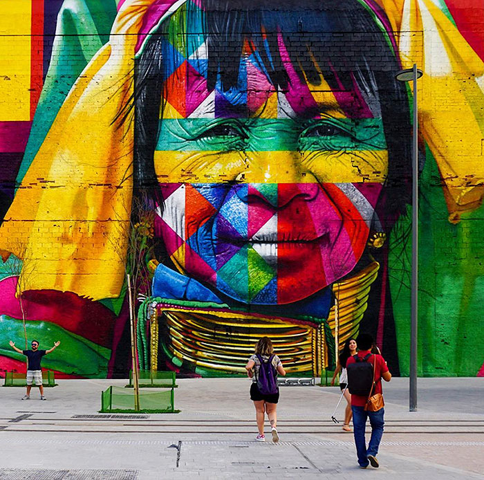 Eduardo Kobra, Brazilian Graffiti Artist, 2016. Mural 'Etnias'  Kobra's piece, 'Etnias' coincided with Rio's 2016 Olympic games and beat the world record for largest mural completed by a single person. His work covered 30,000 sq ft. The work illustrates five faces from five continents - representing the five Olympic Rings.