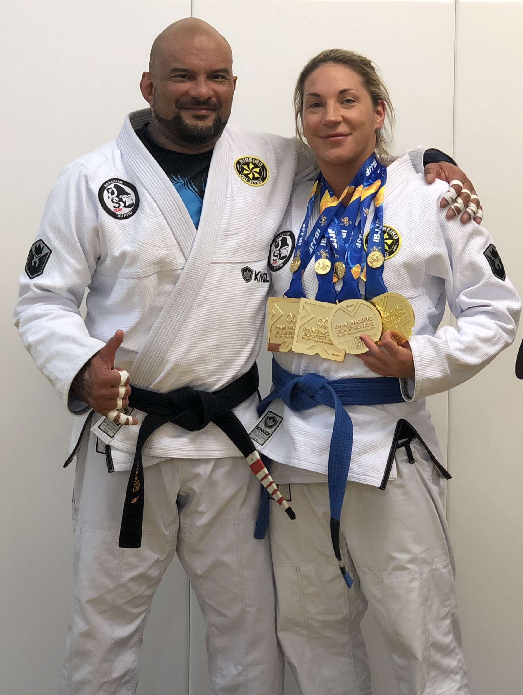 ALIX BARTHOLOMEW - Alix first represented New Zealand in Taekwondo. Over the past two years she has begun training and competing in Brazilian Jiu-Jitsu, working with world renowned, 4th Degree Black Belt, Douglas Santos (seen here with Alix) at the Douglas Santos Team School.She's achieved impressive results already, winning Gold in multiple divisions at the Pan Pacific Jiu-Jitsu IBJJF Championship in October 2018 and the Sydney International Open, also in 2018.Alix now has her sights set on the World Championship in Las Vegas in August 2019.Good luck, Alix.