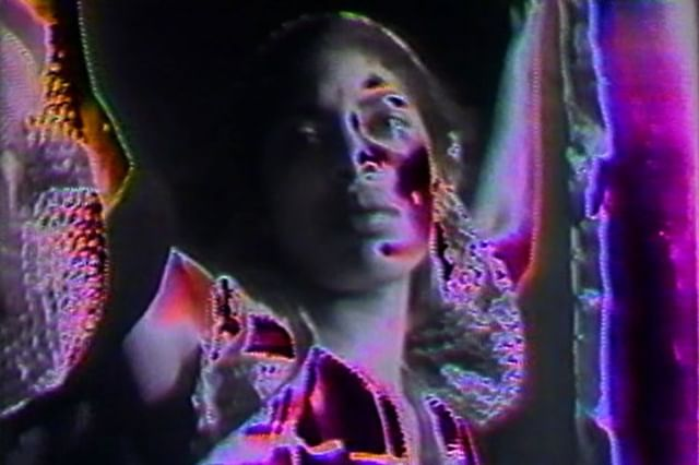 A still from BARBARA MCCULLOUGH'S WATER RITUAL #1: AN URBAN RITE OF PURIFICATION (1979).   Shot in 16mm black and white, the film studies Black women's constant struggle for spiritual and psychological space, inspired by a friends own mental struggles, who Barbara says 'retreated into her own internal being.'   With ties to African-Diaspora cosmology, this film is both symbolic, and ritualistic.     