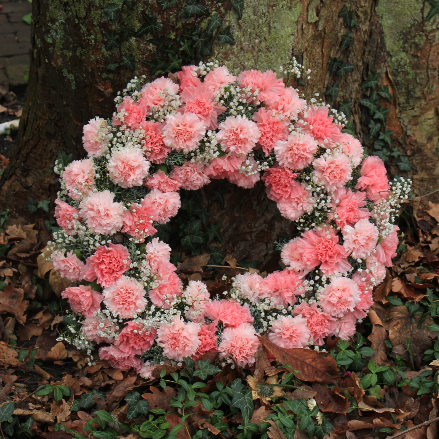 Wreaths. - Wreaths can be made with a variety of flowers and colours according to seasonal availability. Wreaths are more appropriate to be sent to the funeral service.Available in SmalL, Medium and Large