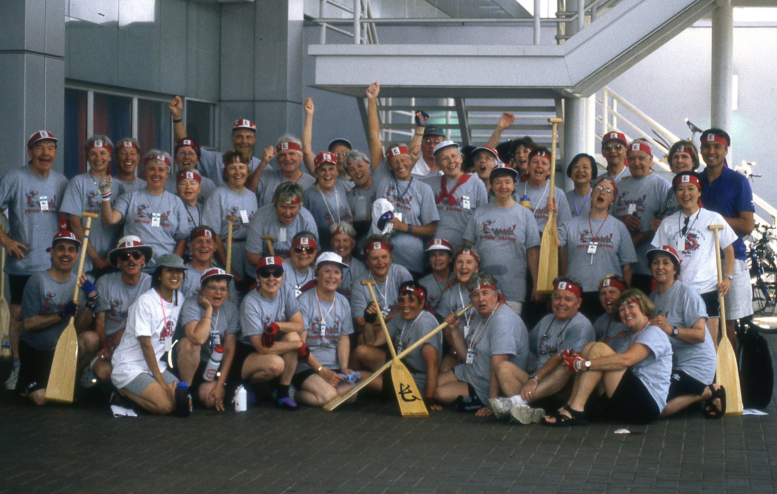 Nothin' Dragon team photo (2000) vintage racing shirts and wooden paddles (no sign of carbon fibre paddles yet). Can you spot Dan, Pat and Ann?