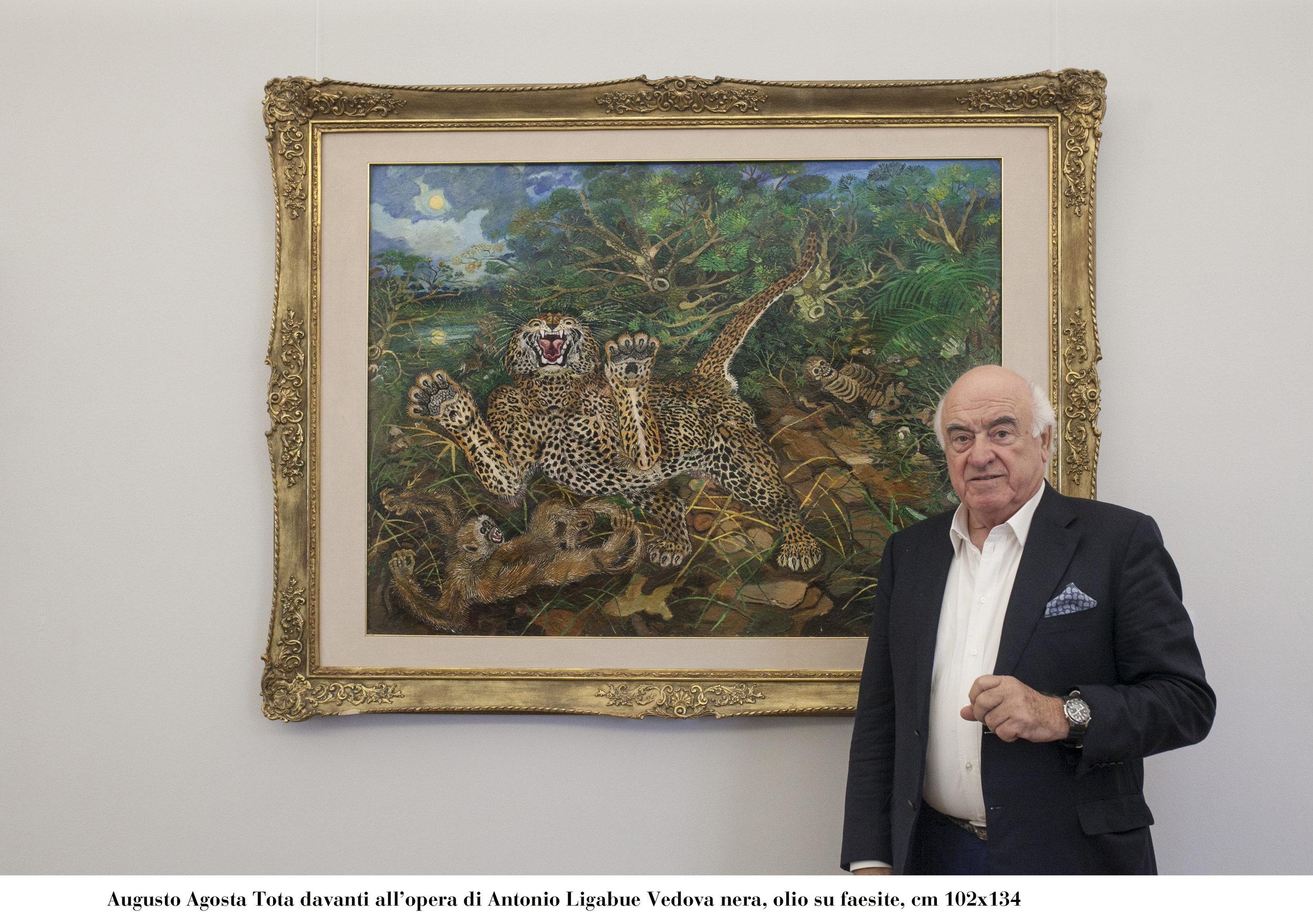 "Augusto Agosta Tota standing next to Antonio Ligabue's ""Black Widow"", oil on faesite, 102cm x 134cm."