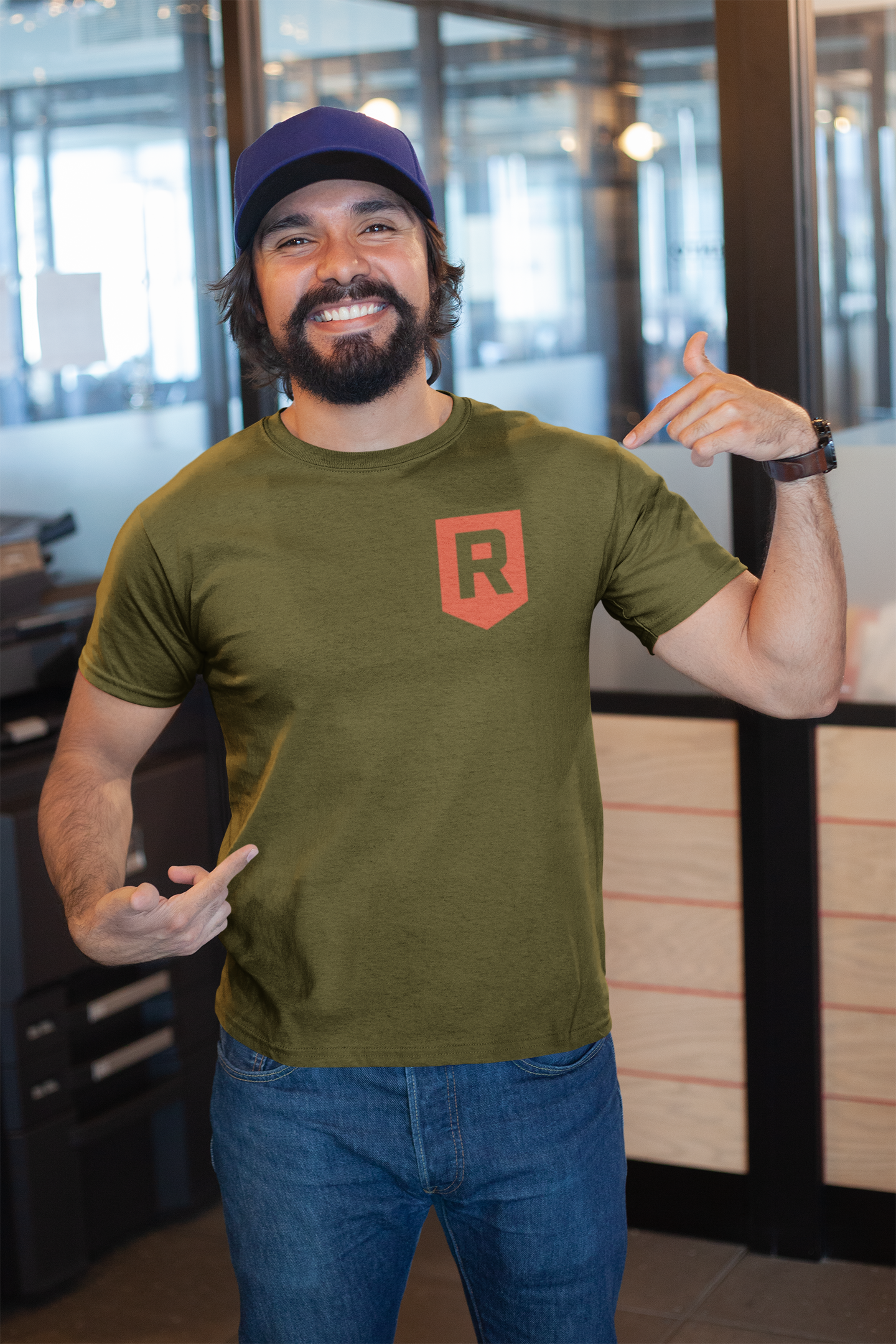 mockup-of-a-happy-customer-showing-off-his-t-shirt-inside-a-modern-office-26189.png