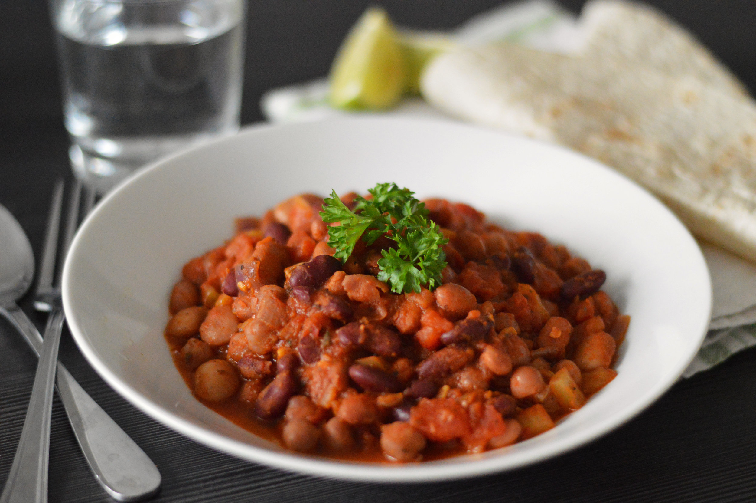 Mixed Bean Chilli - This vegan bean chilli recipe plays with Mexican flavours to create a warm bowl of aromatic, smokey and flavourism bowl of chilli.