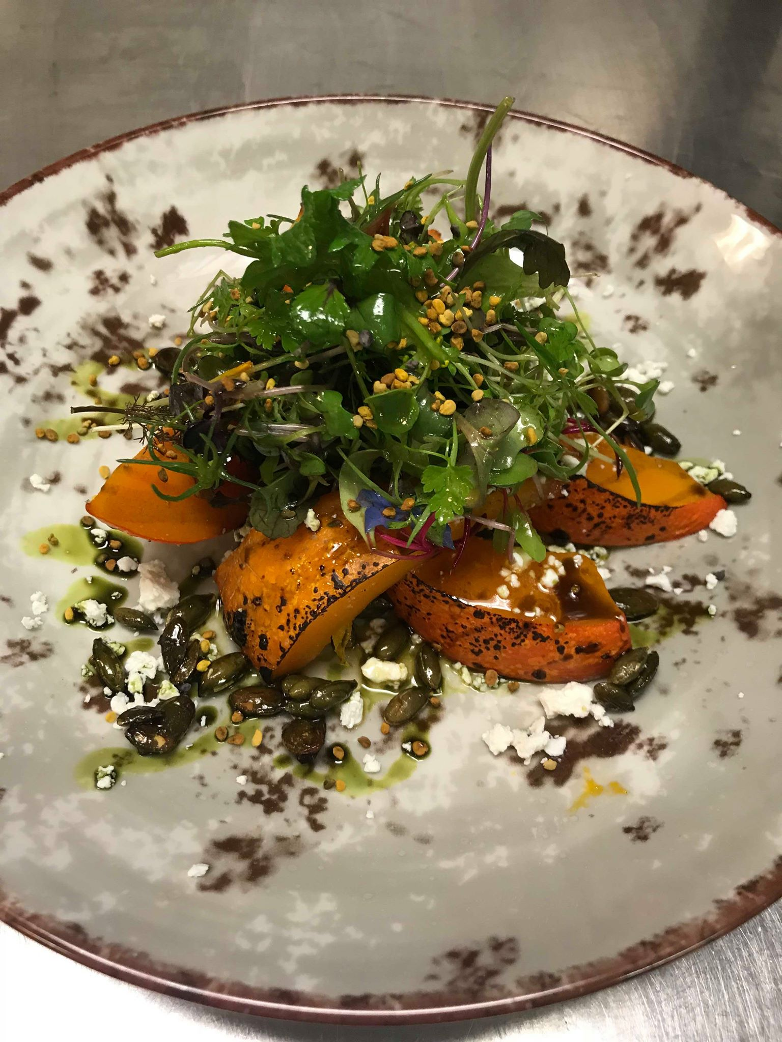 Pumpkin glazed in homemade dandelion honey, pumpkin seeds, pollen, micro herbs & dill oil