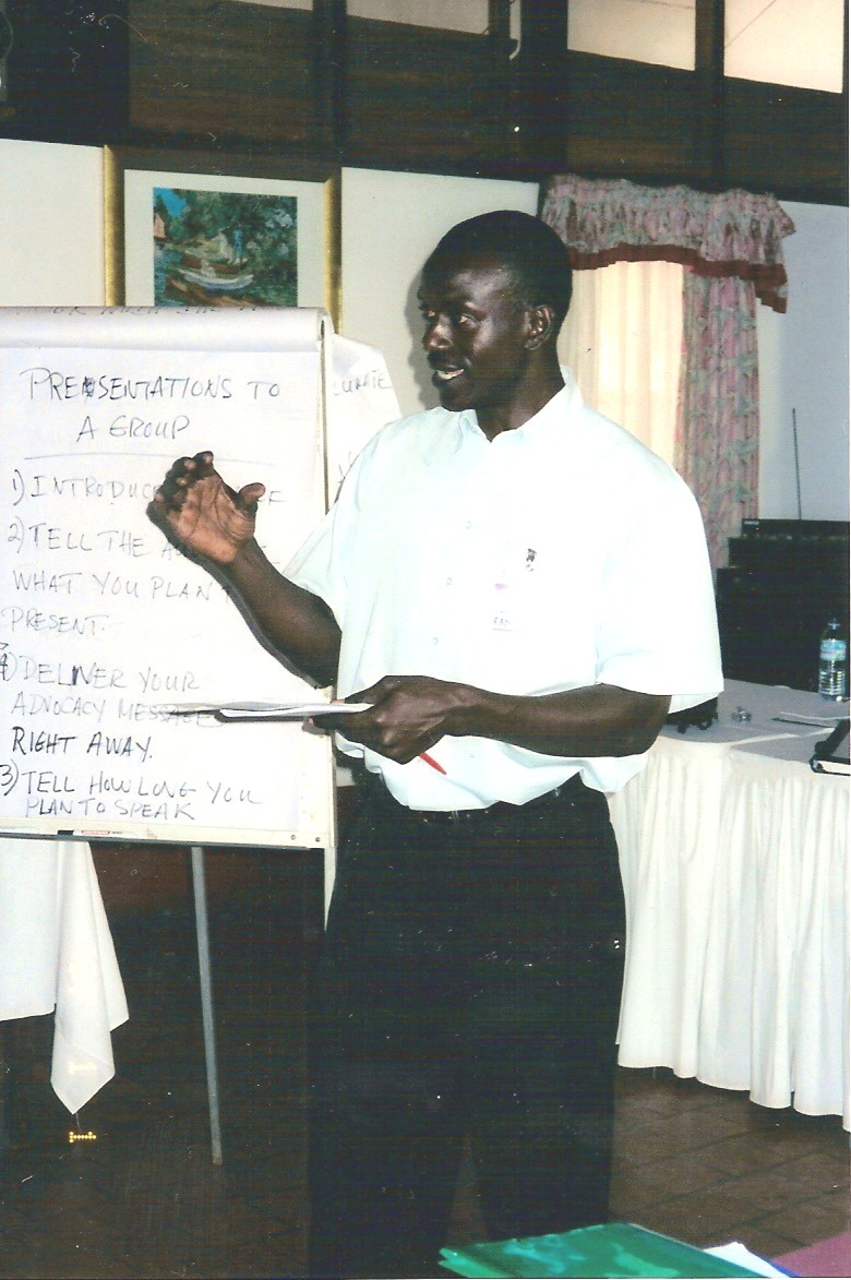 A participant in the Coalition training practices his group presentation skills.
