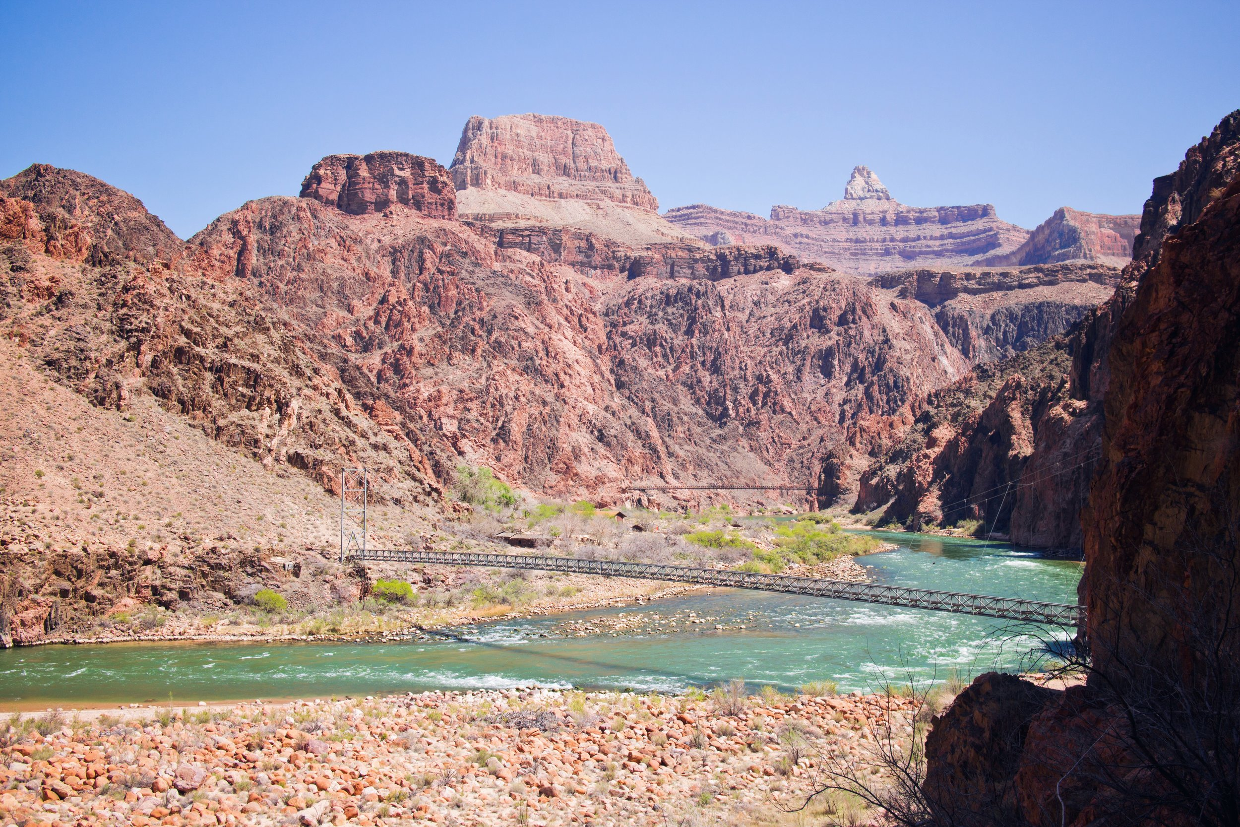 The Colorado River with Bright Angel Bridge in the foreground