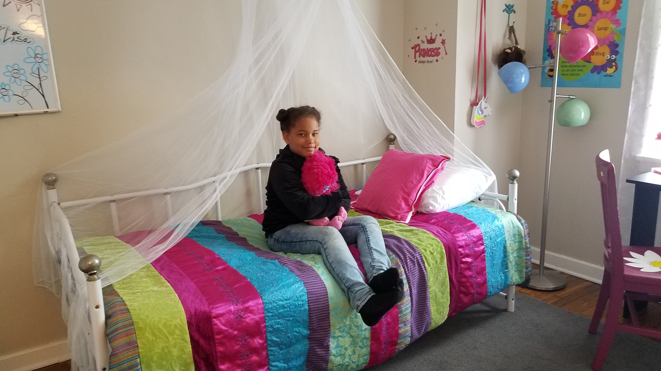 Colorful, comfortable and creative space for a beautiful little girl.