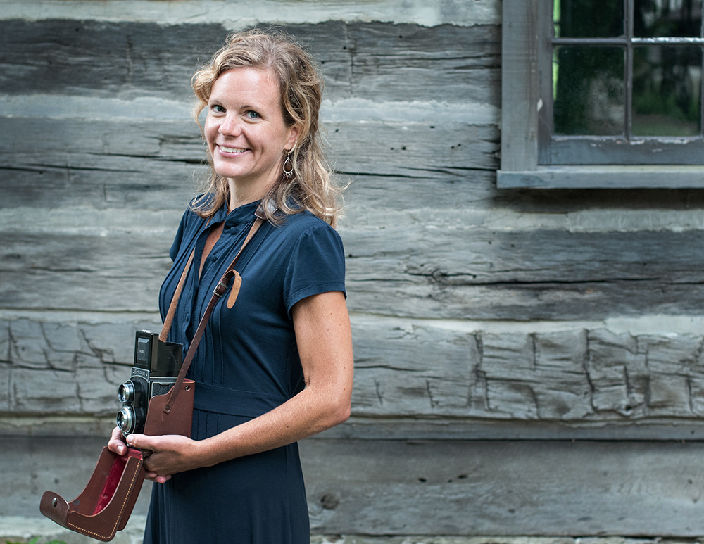 SUSTAINABILITY AGENT   Elizabeth Flinsch grew up in Afton, Minnesota on the farmland above the bluffs of the St. Croix River. Keeping bees, harvesting maple sap, and growing food instilled in her a deep love for the land. Currently she teaches photography at a local high school and is the editor of Shots Magazine, a print publication devoted to fine art black and white photography. While she can sometimes be found wandering worldwide with her camera in tow, the Midwest is undoubtedly her home. After being inspired by a brick oven building workshop at the Northhouse Folk School in 2012, she quit a desk job determined to explore the practices of milling local grains and naturally fermented breads. She followed this path and found herself as an apprentice for wood-fired bakers. This stirred a new found love for the small communities of thoughtful food producers sprinkled throughout the midwest. When she travels, she seeks out connections with people who share her respect and fondness for the land, hoping to strengthen the fabric of stewards of our Midwestern home.