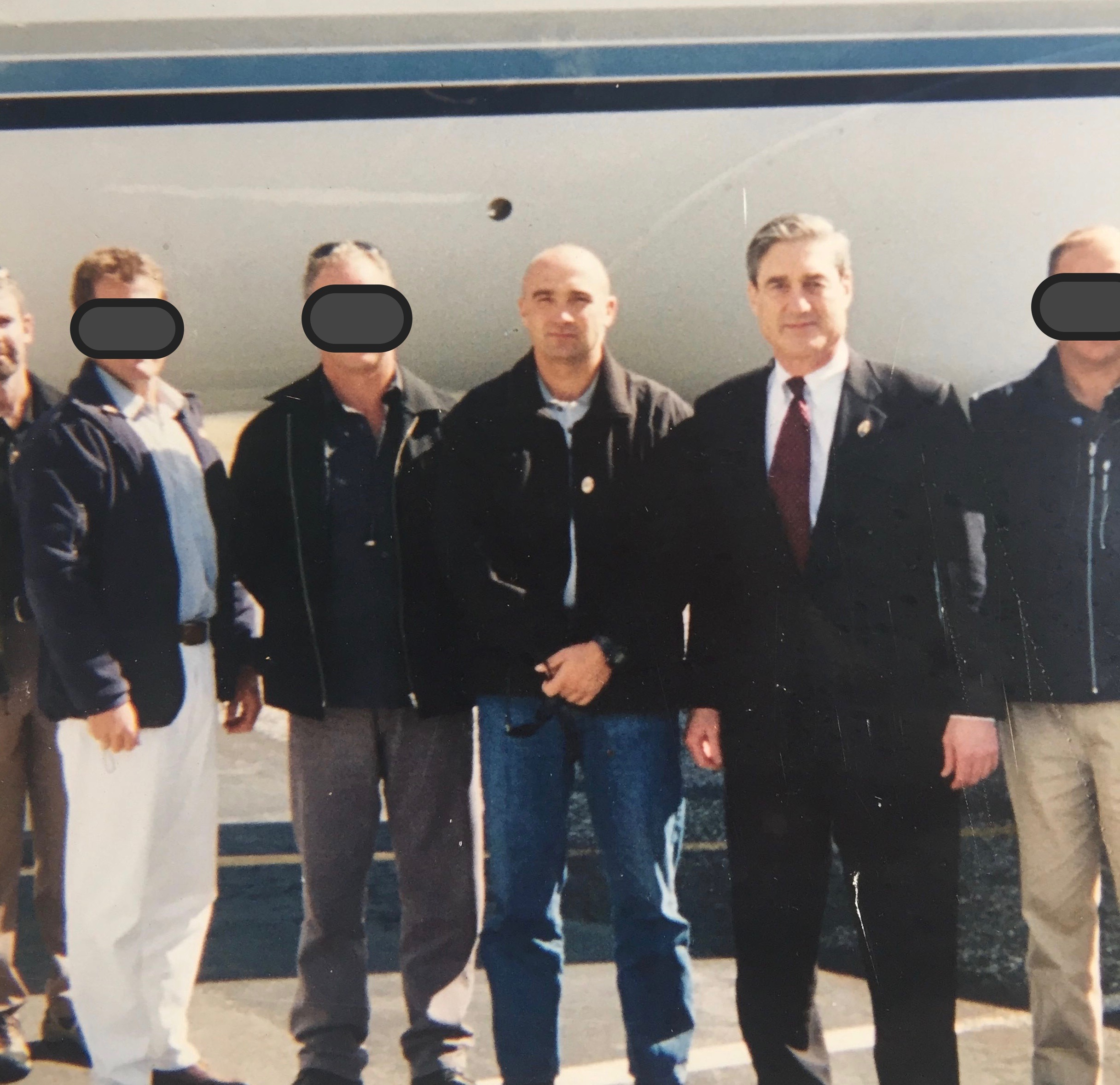 FBI Director with NZ CP Team - The STG providing CP (close protection) to the then FBI Director Robert Muller III whilst he was on a visit to NZ a few years back. Photo taken beside his private jet as he and his entourage head back to the States