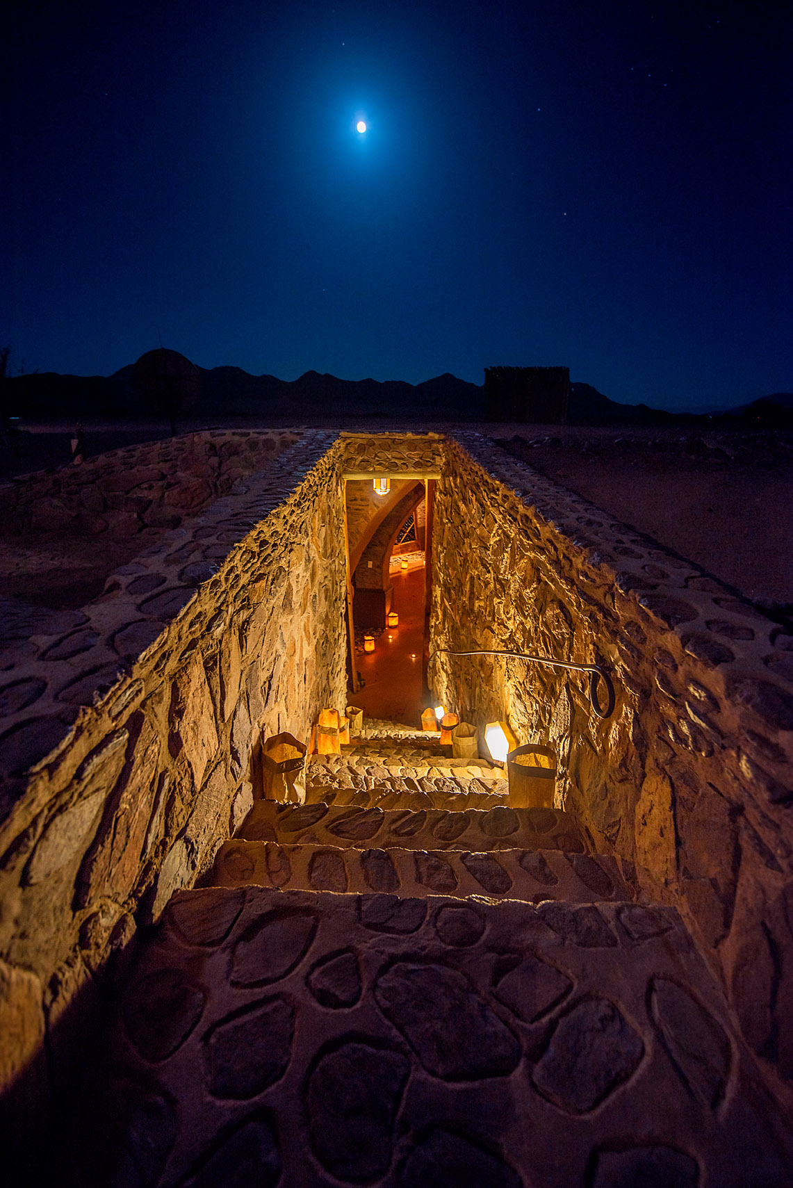 A full moon rises over the stairs leading to Le Mirage's wine cellar.