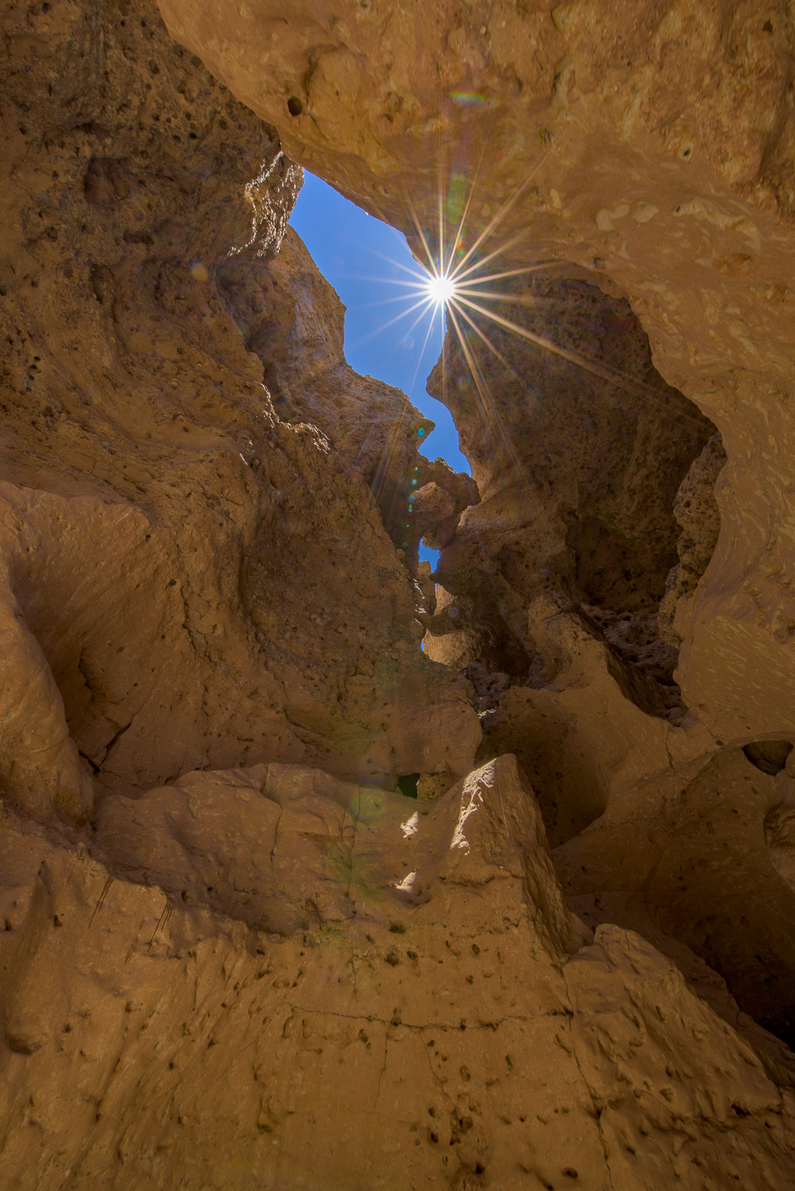 Peering up at the head of Sesriem Canyon.