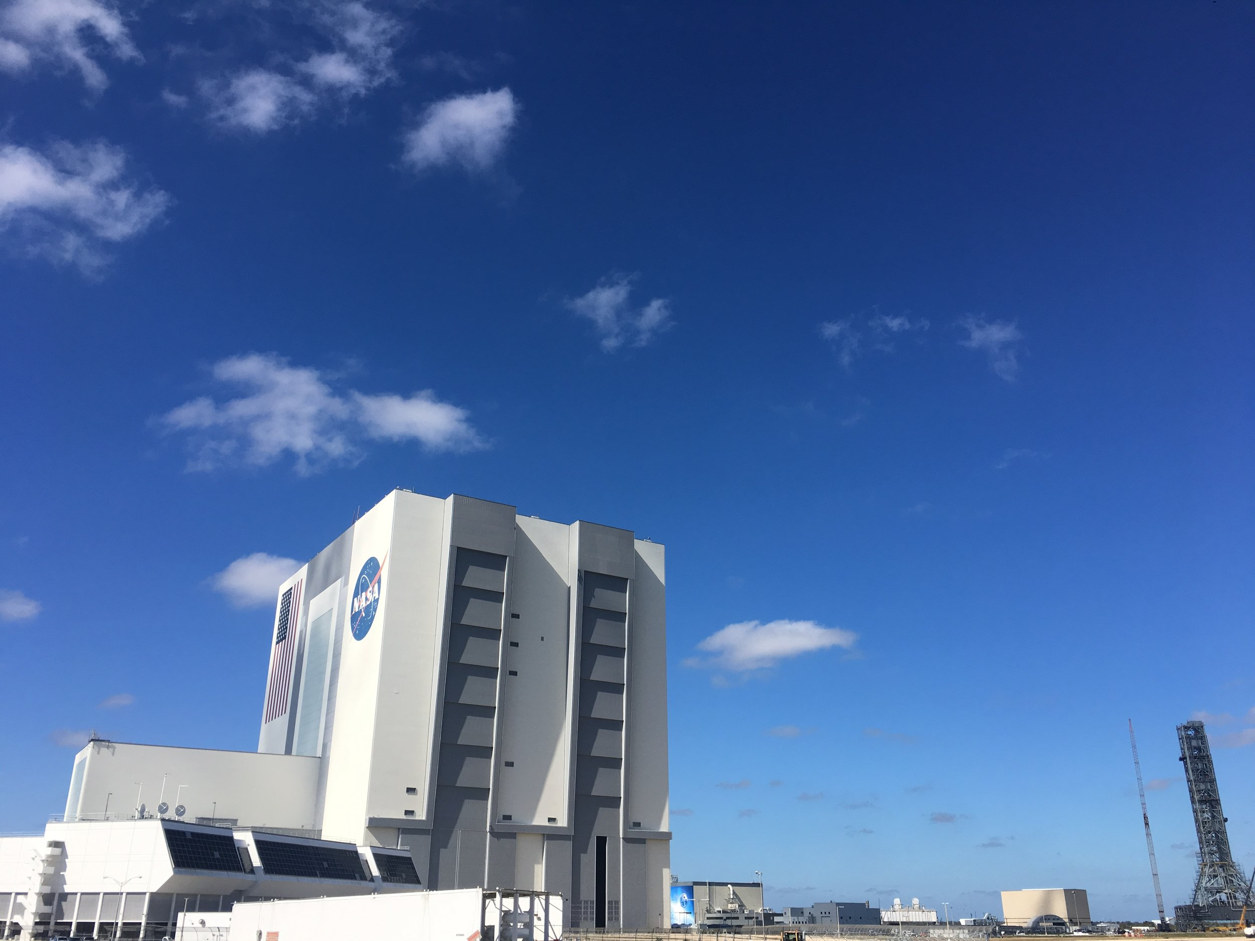 VAB, LCC, Starliner Facility, Shuttle MLP, and SLS Tower seen from the Turning Basin.