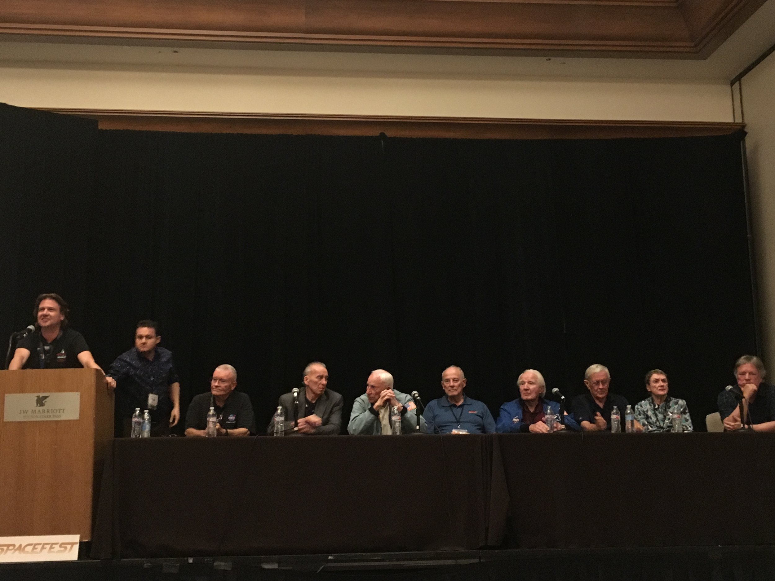 L-R: Spacefest staff/astronomer Nick Howes, moderator/space historian Francis French, astronauts Fred Haise, Walt Cunningham, Al Worden, Jack Lousma, Vance Brand, Charlie Duke, astronaut nurse Dee O'Hara, and Rick Armstrong (son of Neil).