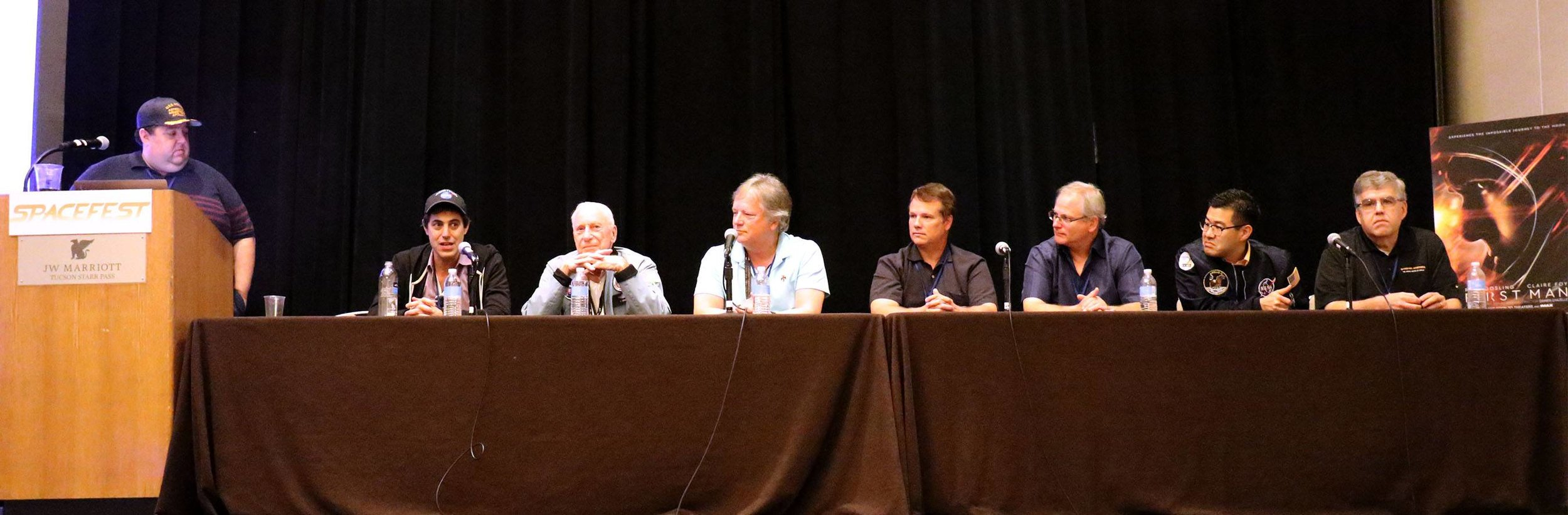 L-R: Moderator Robert Pearlman, Josh Singer, Al Worden, Rick Armstrong, Mark Armstrong, Chris Calle, Ryan Nagata, and Rick Houston. (Photo: Tom Usciak)
