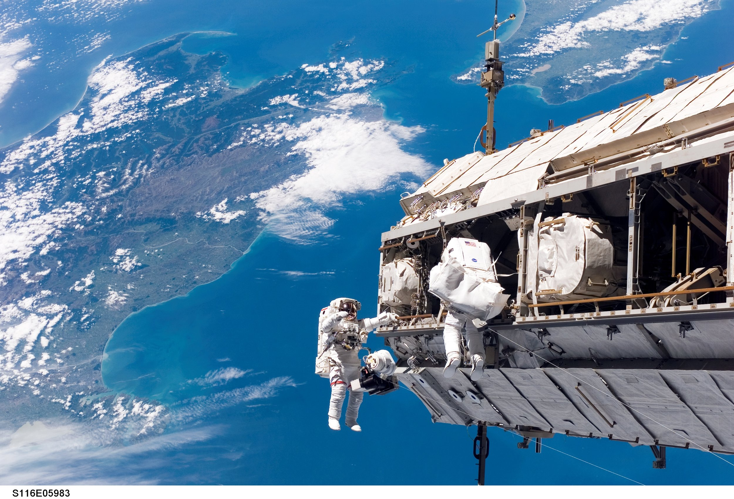 Curbeam (left) installing the International Space Station's P5 truss over New Zealand during STS-116. (Photo: NASA)