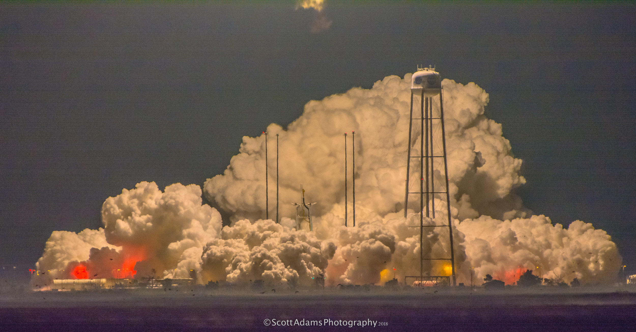 The deluge system produces a massive cloud of water vapor immediately after launch. This is a stunningly good photo of that phenomenon at night. (Photo: Scott Adams)
