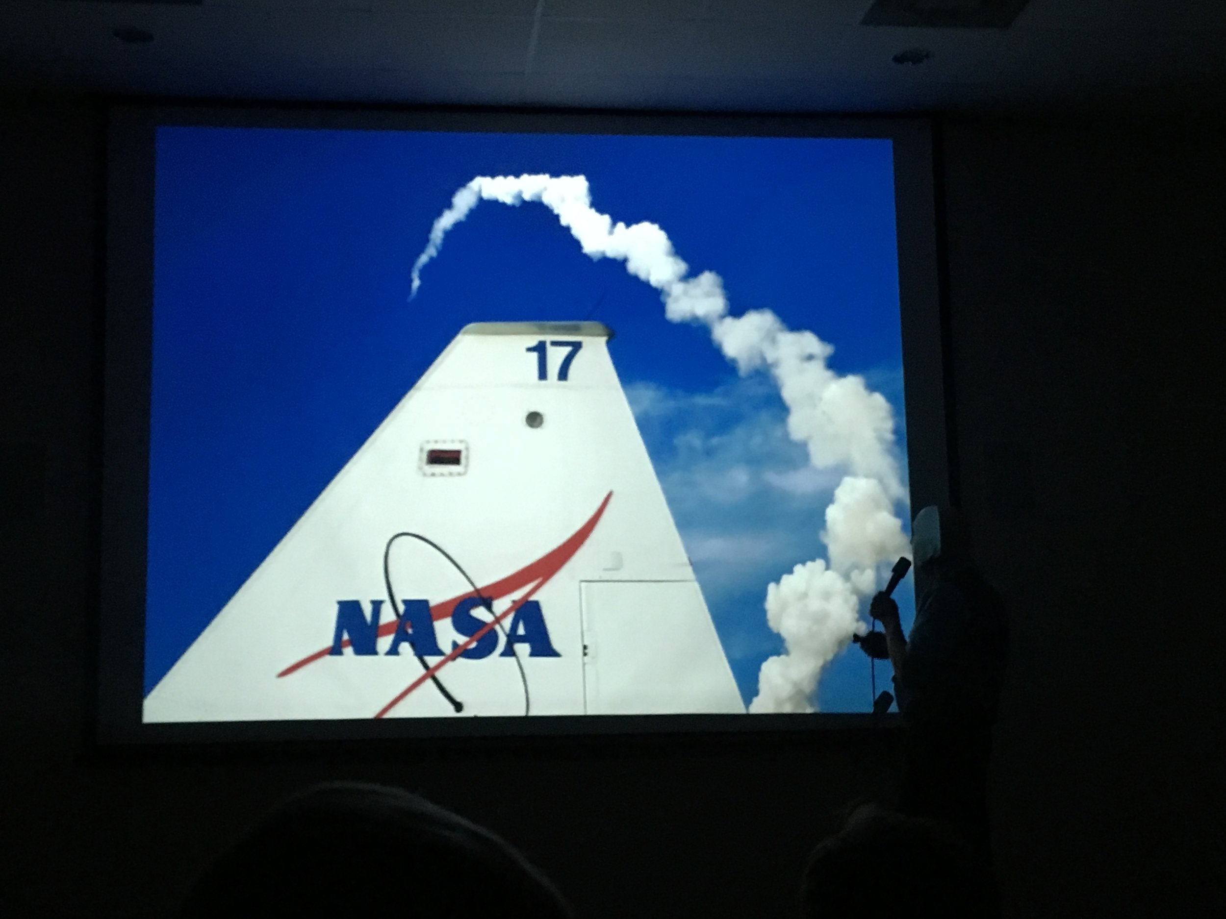 A Shuttle launch arcs over the tail of a T-38. (Slide image: Story Musgrave)