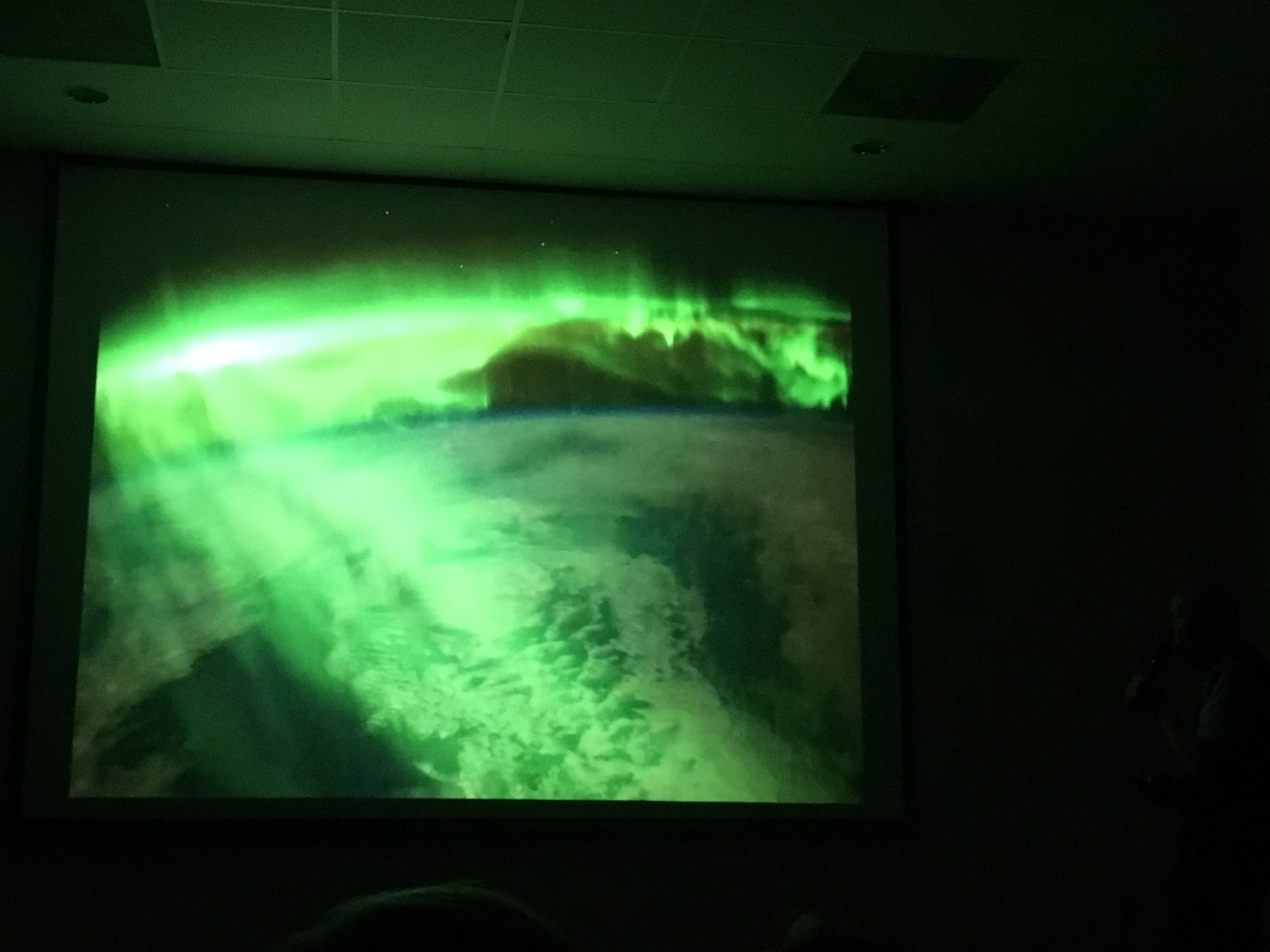Surfing atop aurorae in Earth orbit. (Slide image: Story Musgrave/NASA)
