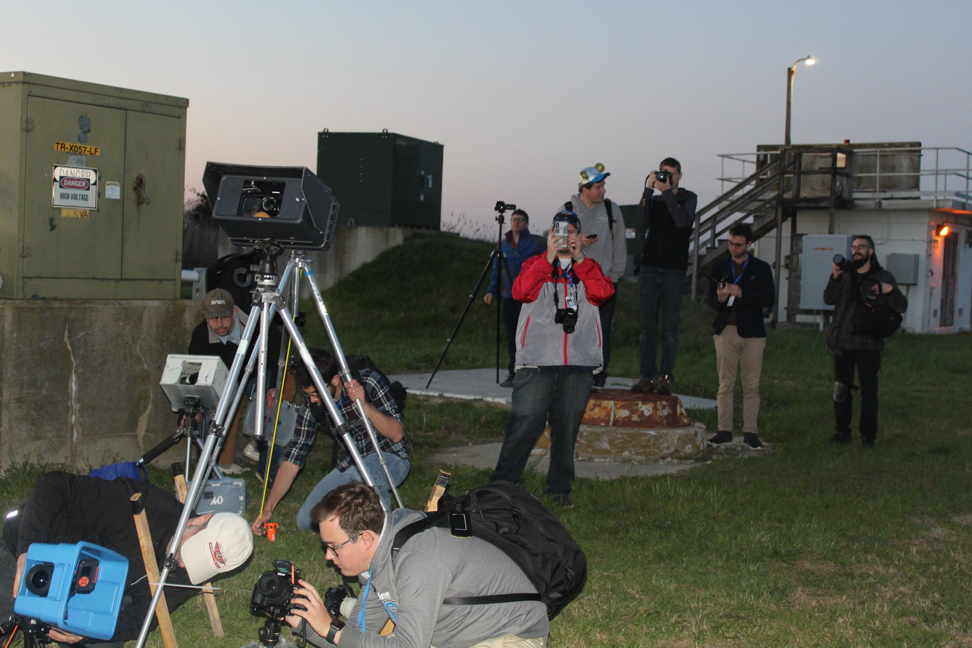 Photographers assemble their remote cameras at the launchpad after the pre-launch press briefing. (Photo: Jean Wright)