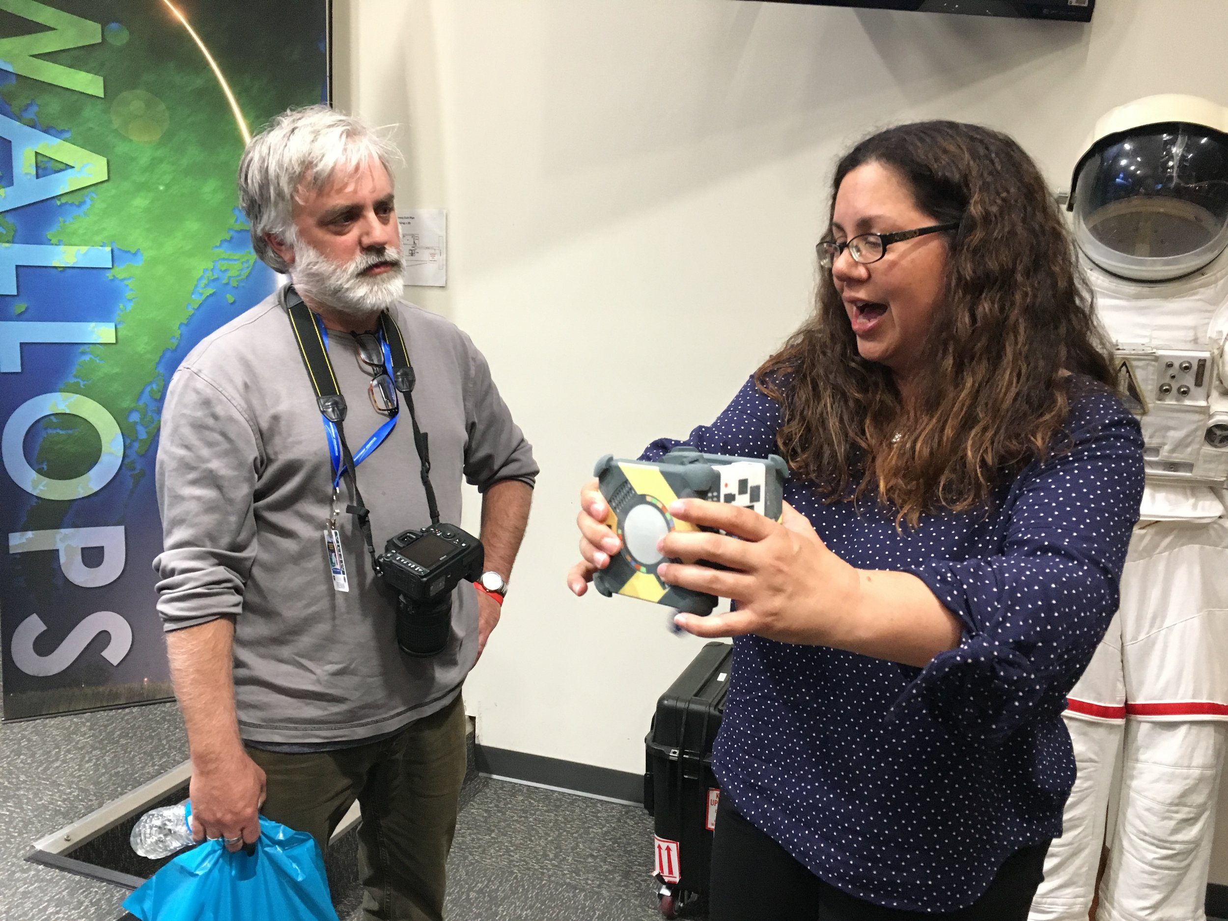 Maria Bualat of NASA Ames answers questions about an Astrobee model to a media member.