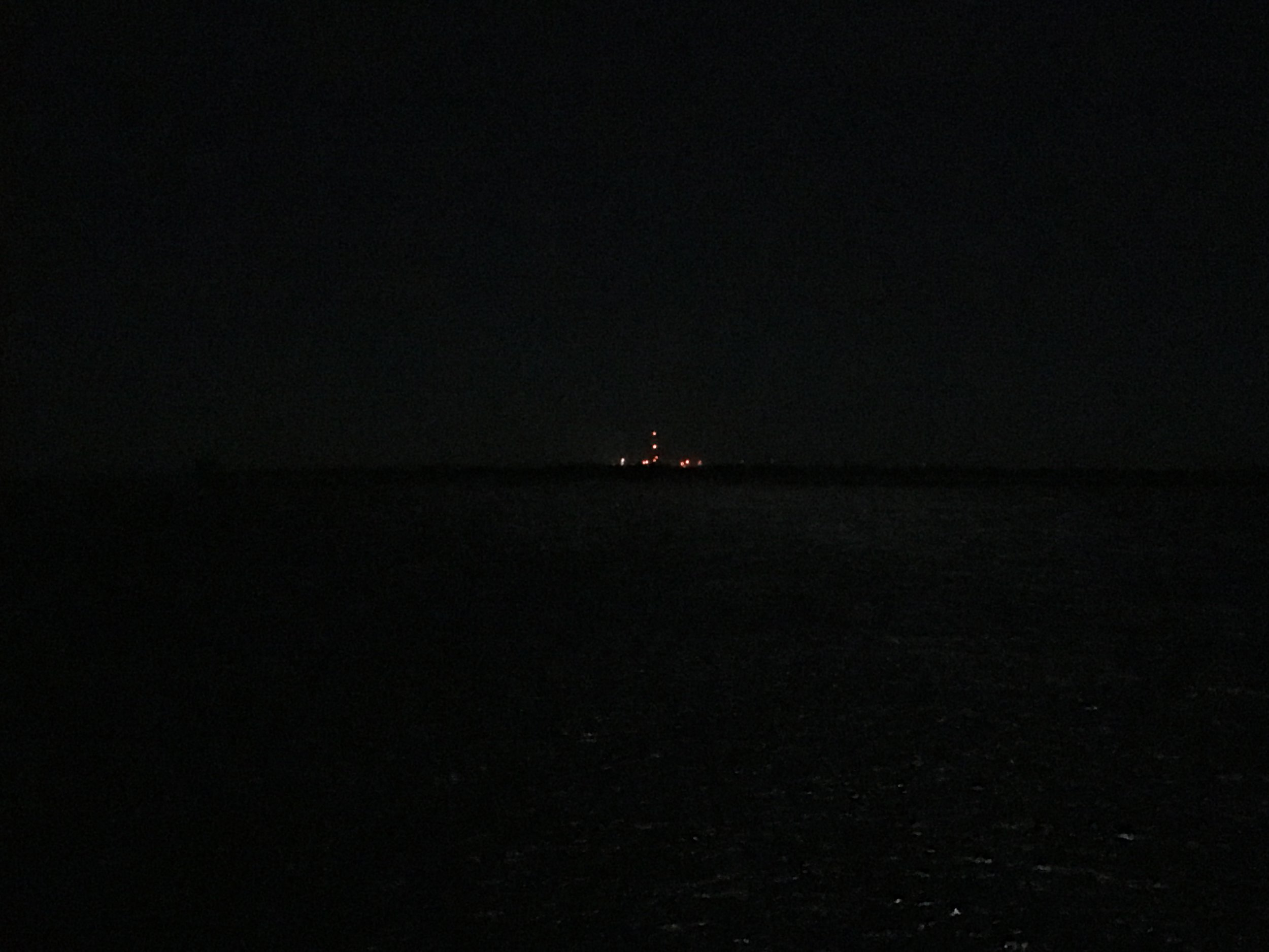 The lights of the launchpad seen from Chincoteague Island on a cool, pre-launch night.