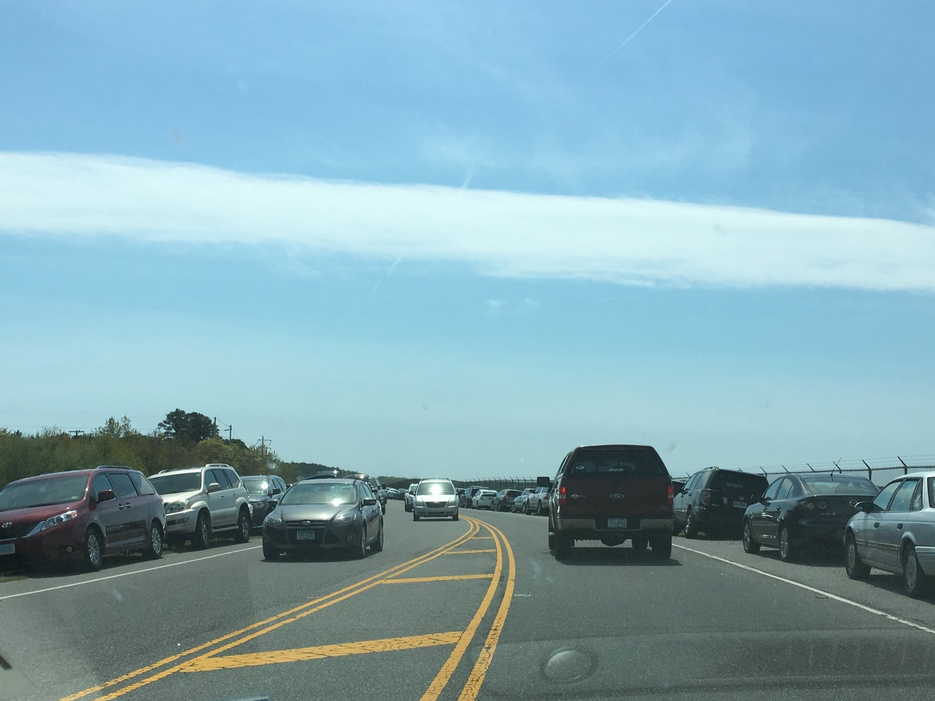 Traffic gathered to watch the launch along the road into Chincoteague.