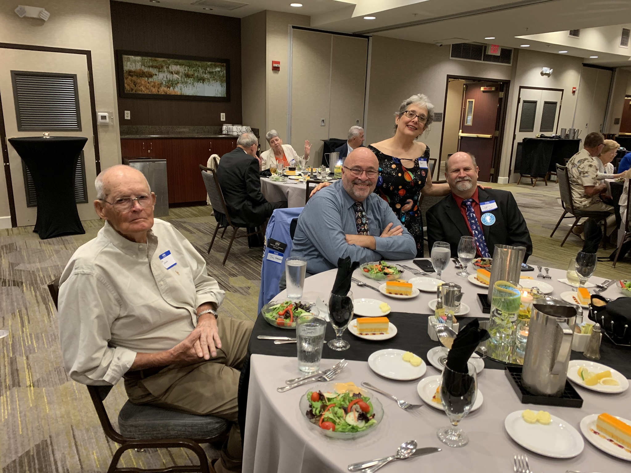 L-R: Former NASA pilot and USAF astronaut Al Crews, mission-patch artist Tim Gagnon, and spaceflight communicators Beverly Rother and Chris Boyd ready for an exciting panel! (Photo: Space Pioneers)