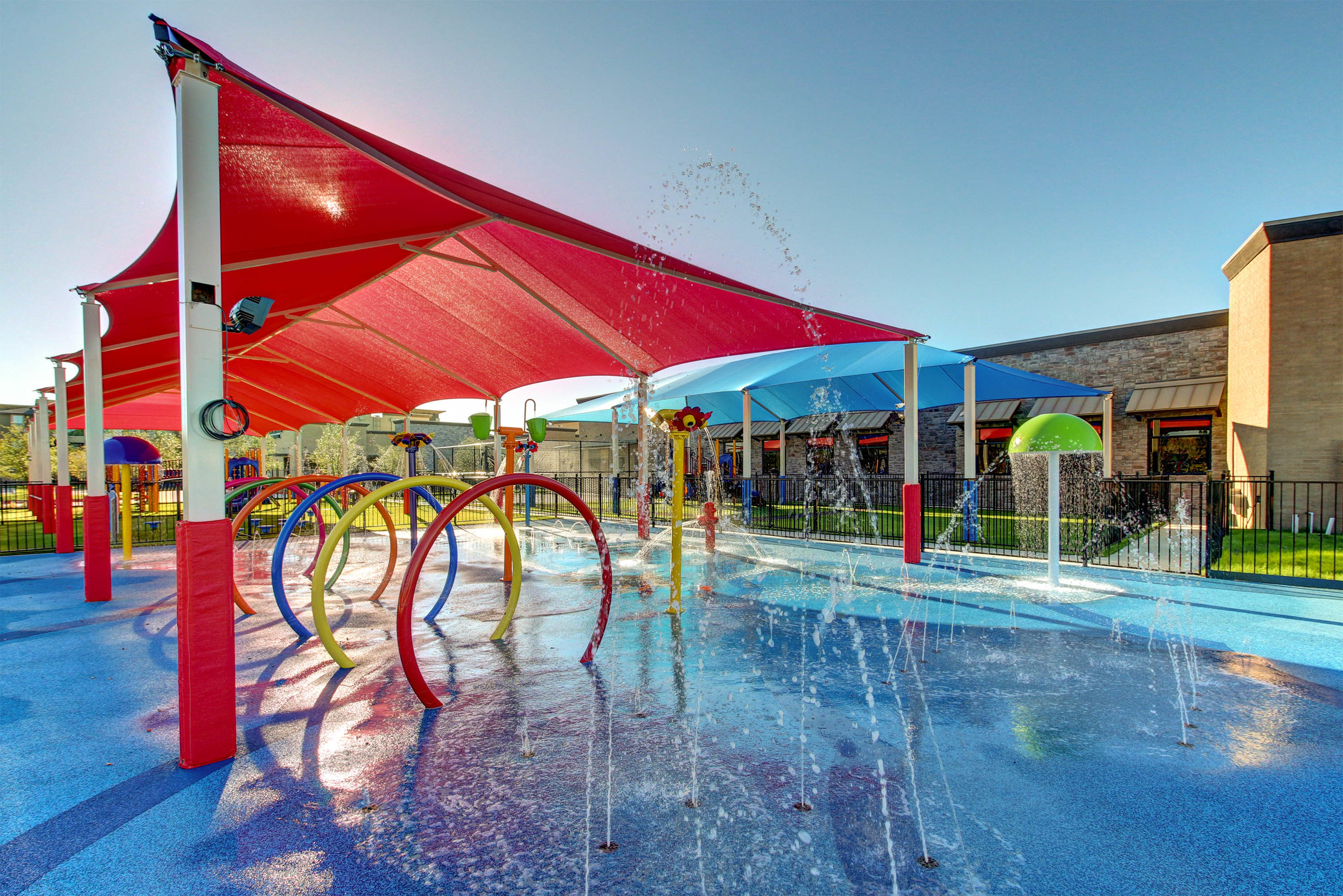 COOL OFF THIS SUMMER... - Most of our locations are equipped with splash zones, and covered play grounds. Our Trophy Club location has an amusment park style Ride-Along train.