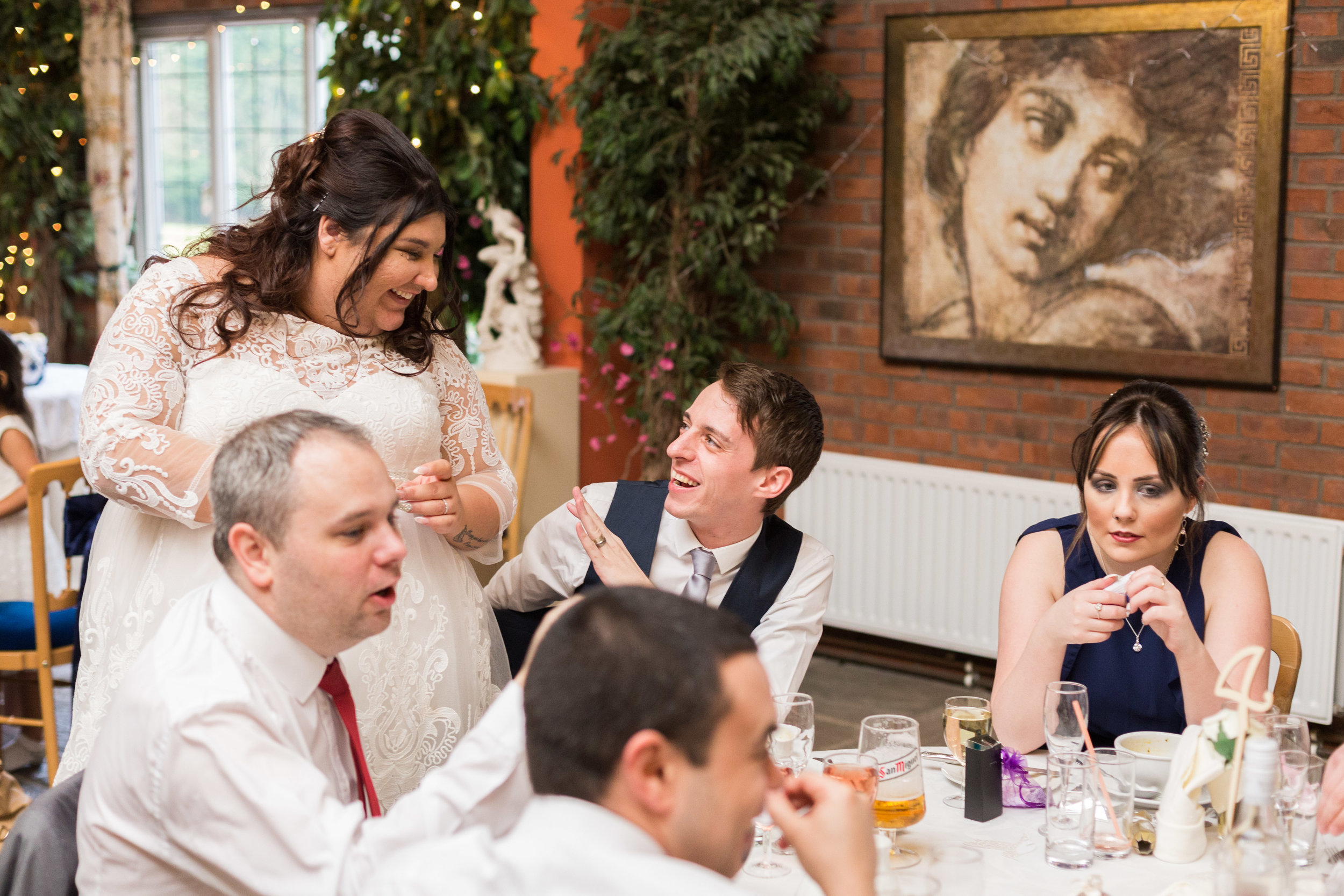 Brides shares a moment with guests, Heskin Hall