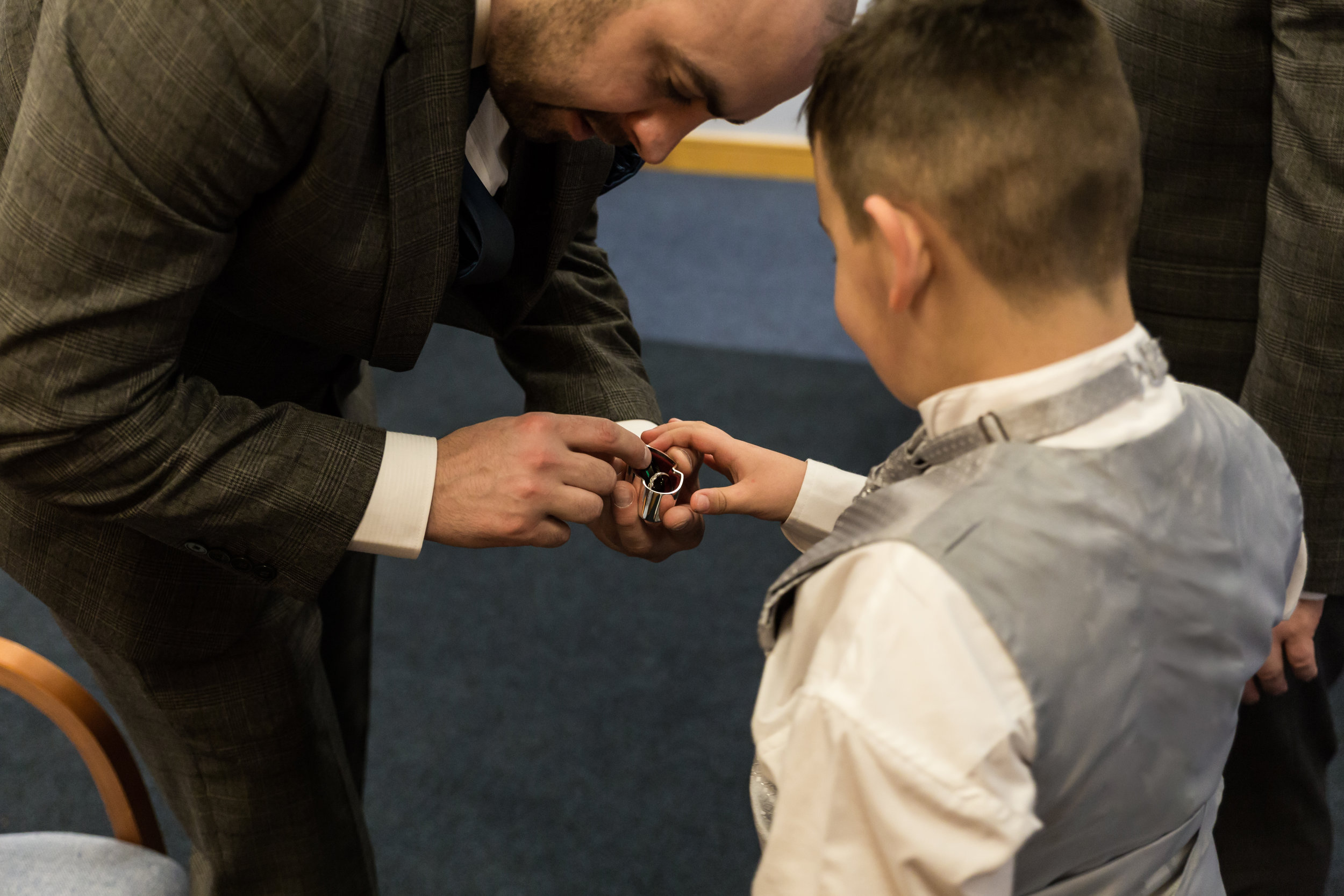 Ring bearer and the best man share a moment, at blackburn registry office