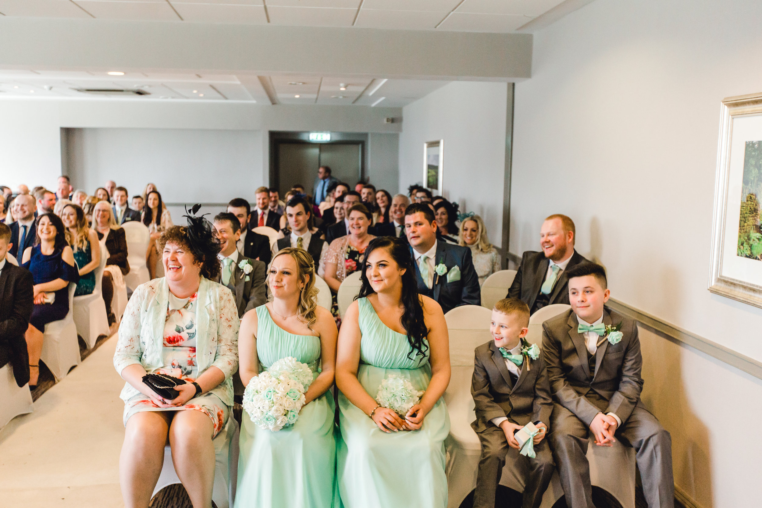 Wedding guests reactions at a wedding ceremony