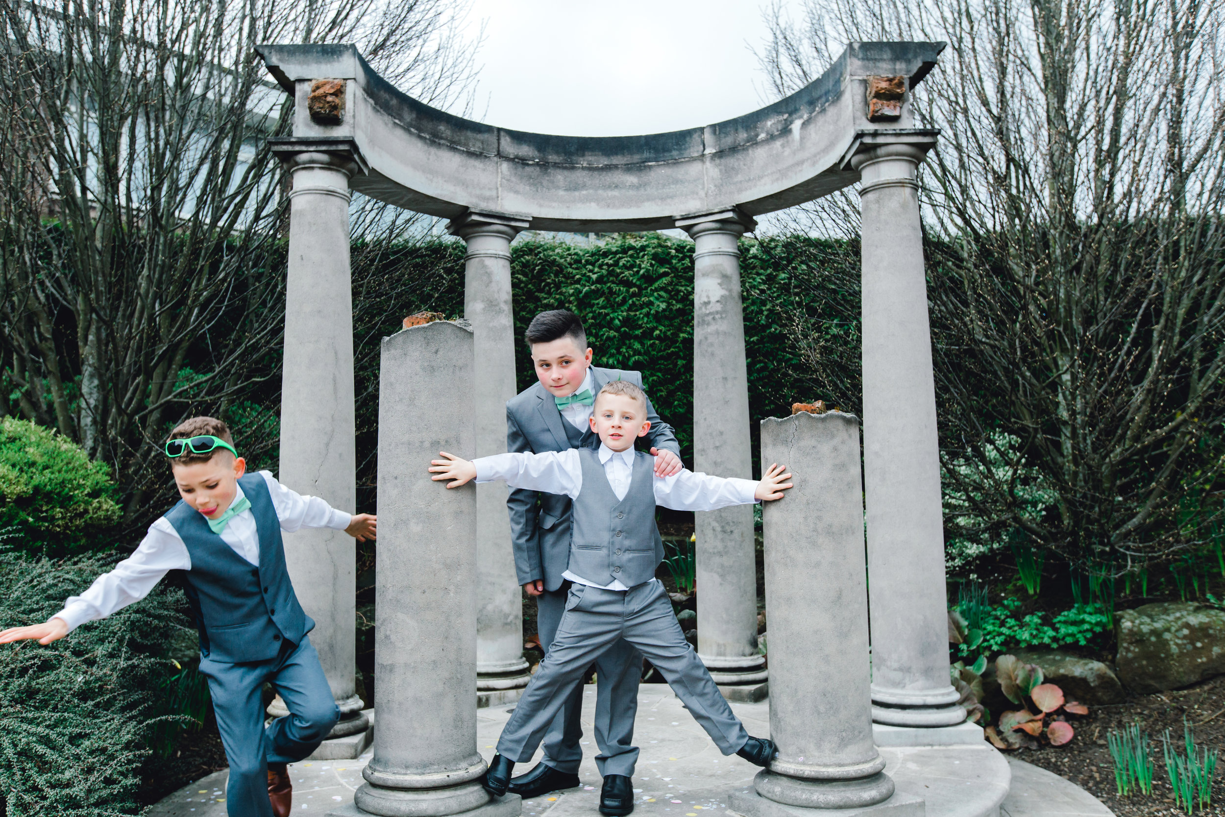Funny kids at a wedding during the formal photos