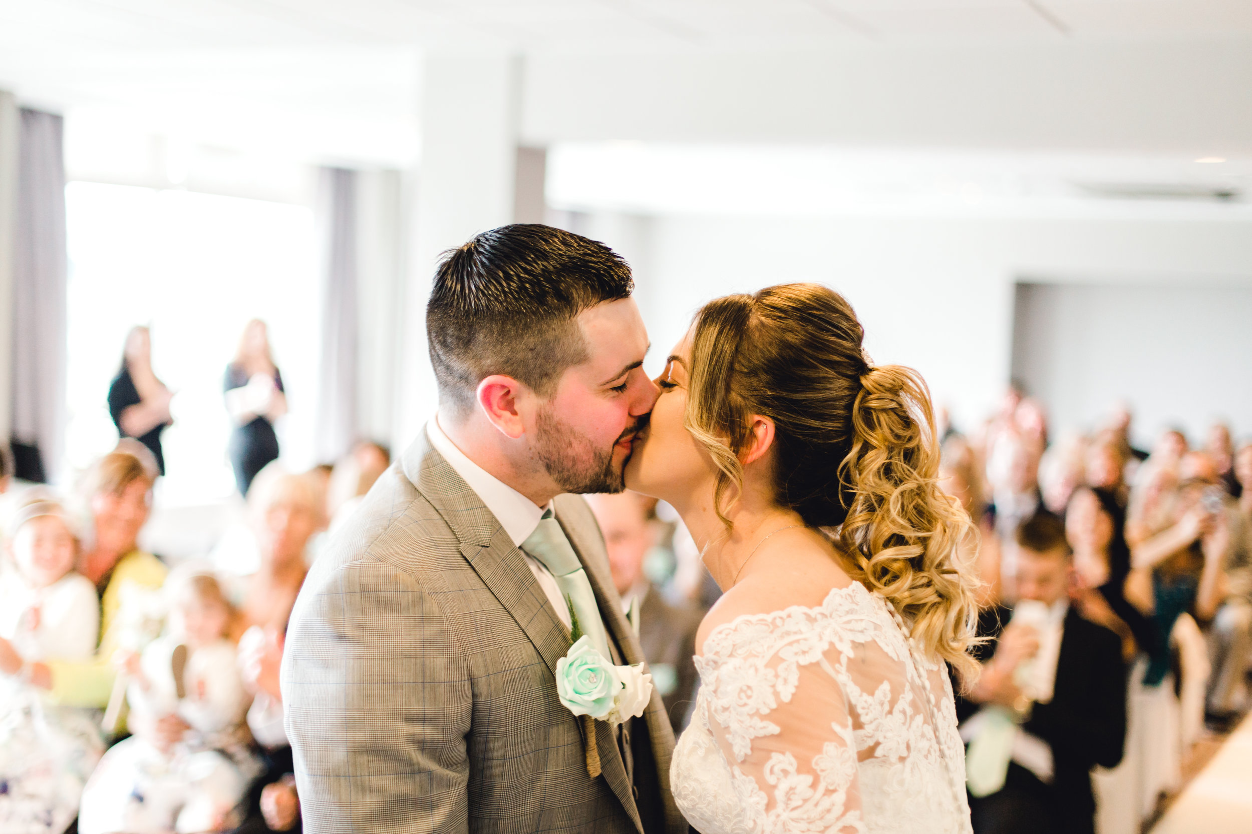 The first kiss photo at cedar court hotel wedding in huddersfield