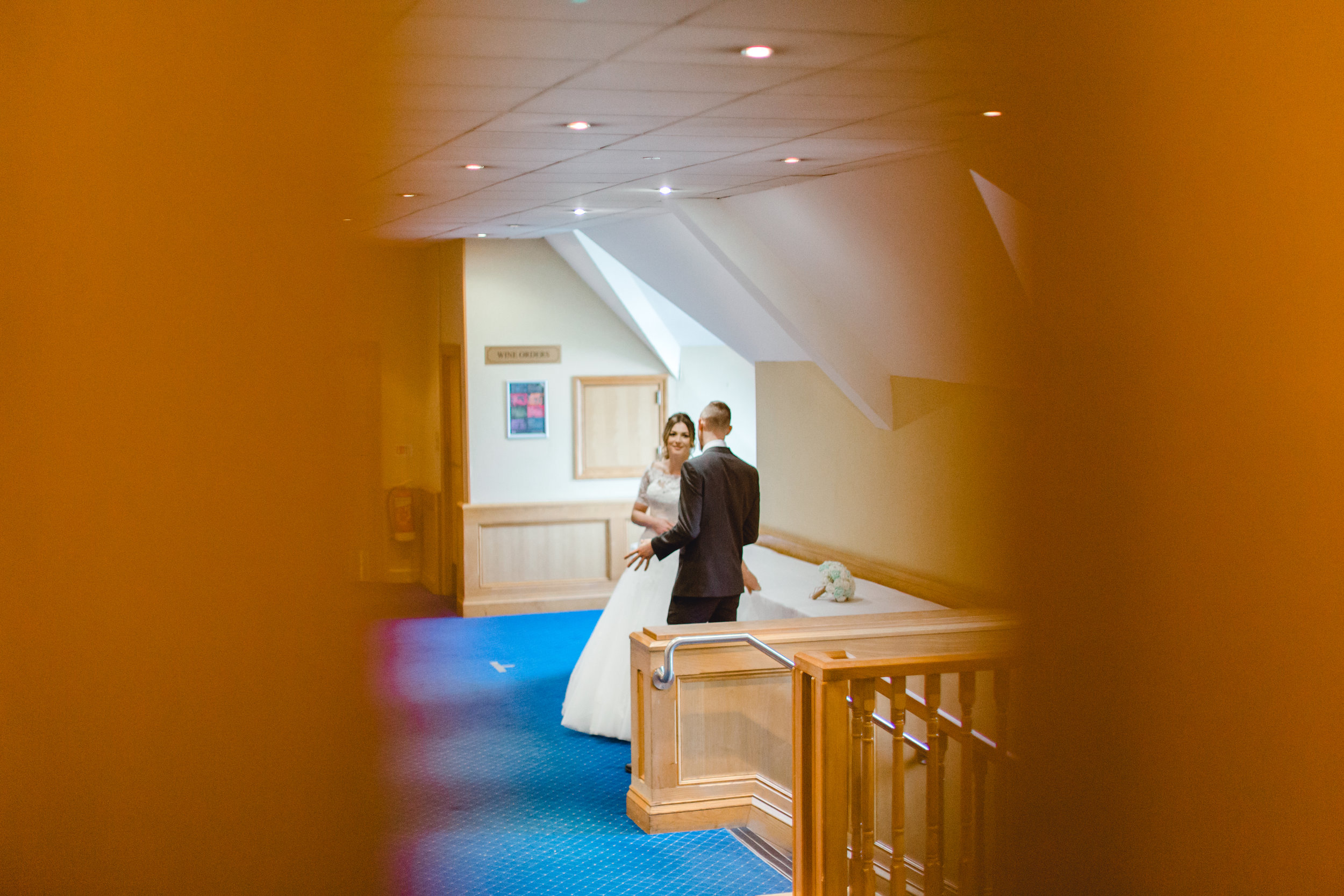 Image of bride and groom before entering the wedding breakfast room