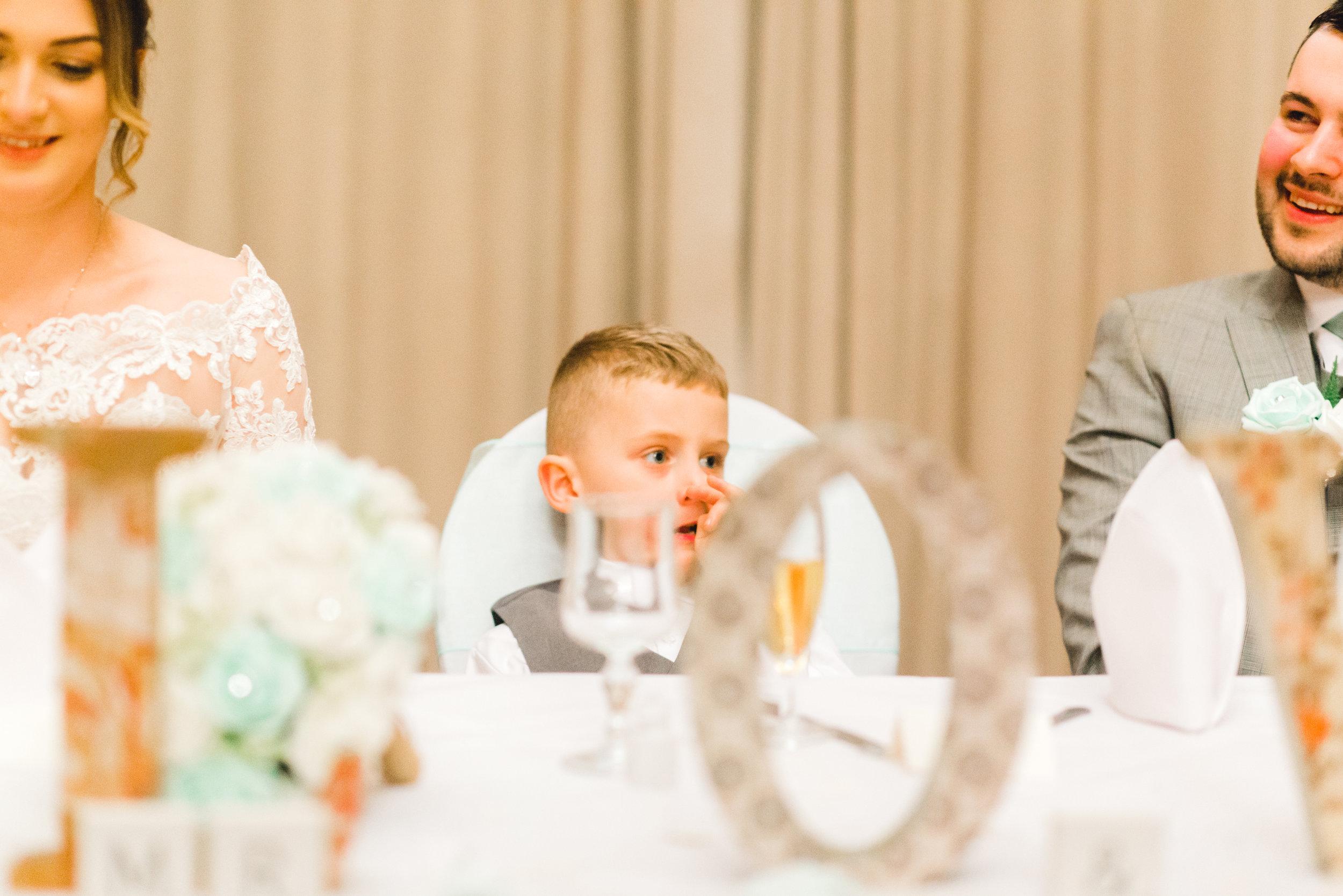 little boy picks his nose during wedding speeches