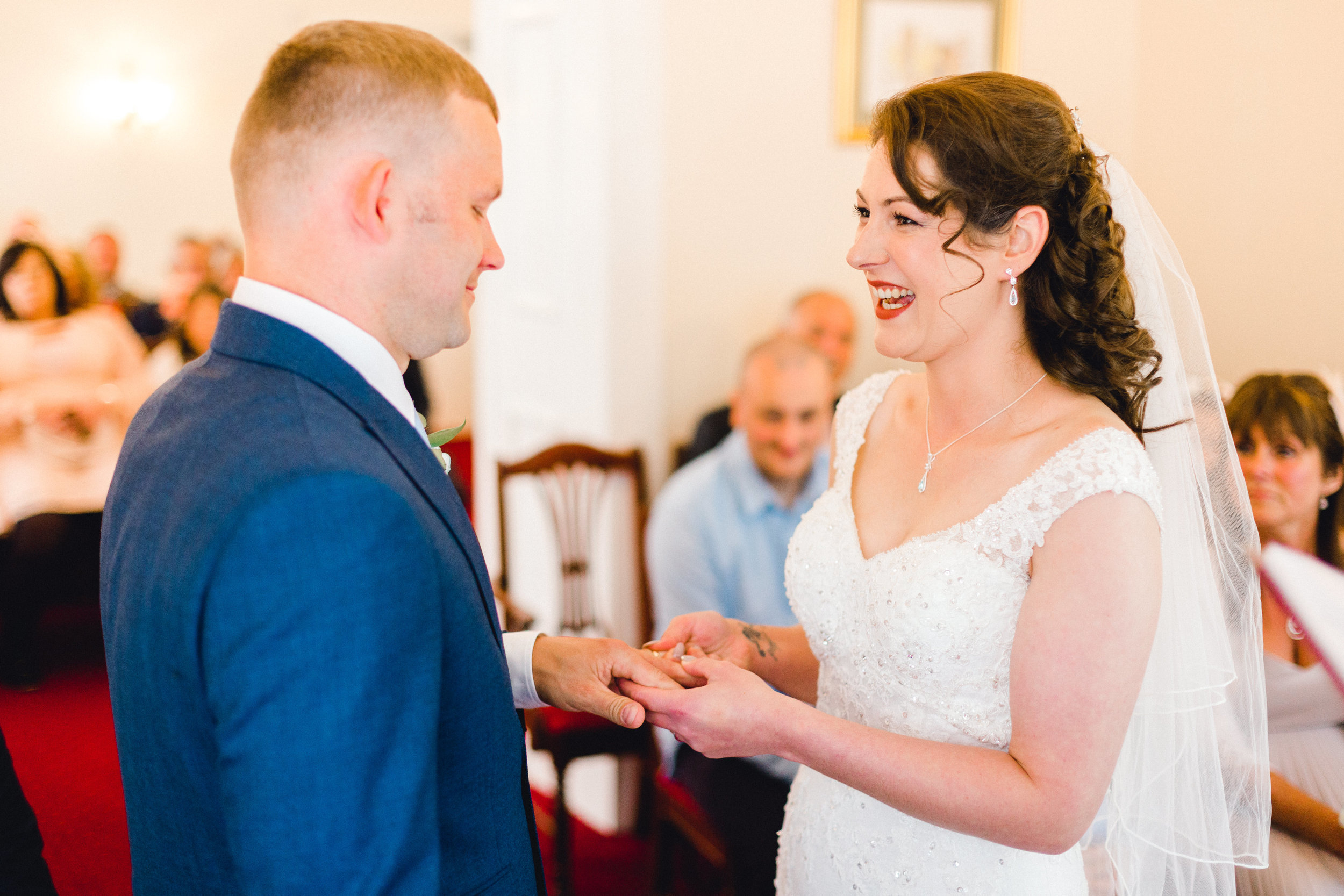 exchanging of rings during wedding ceremony at Llwynegrin Hall