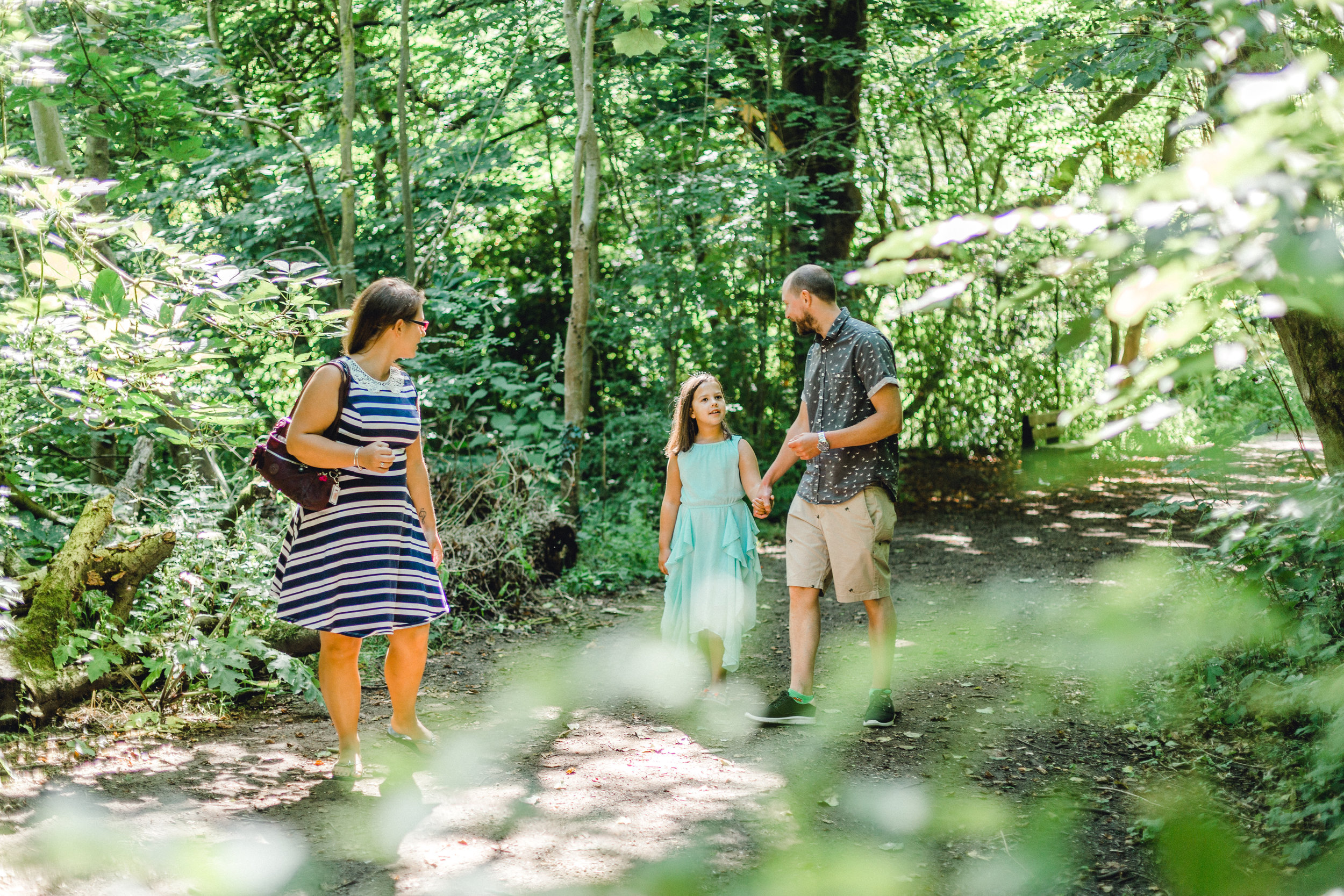Family enjoying a moment together during pre wedding shoot at Fletcher Moss Botanical Gardens