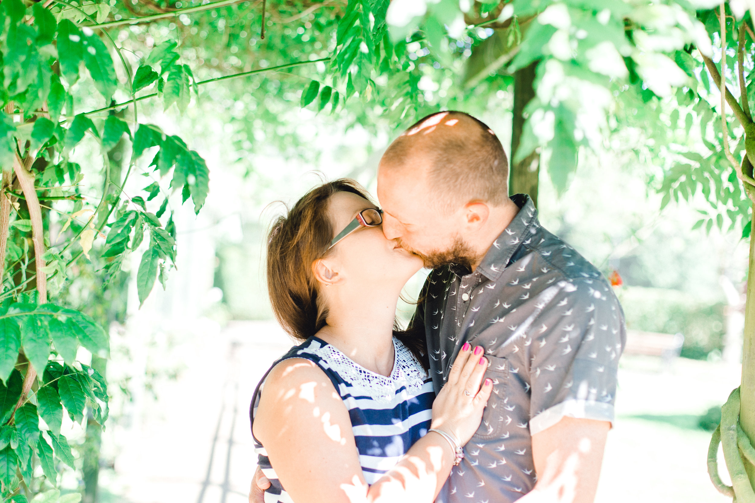 Couple kissing during engagement shoot at Fletcher Moss Botanical Gardens