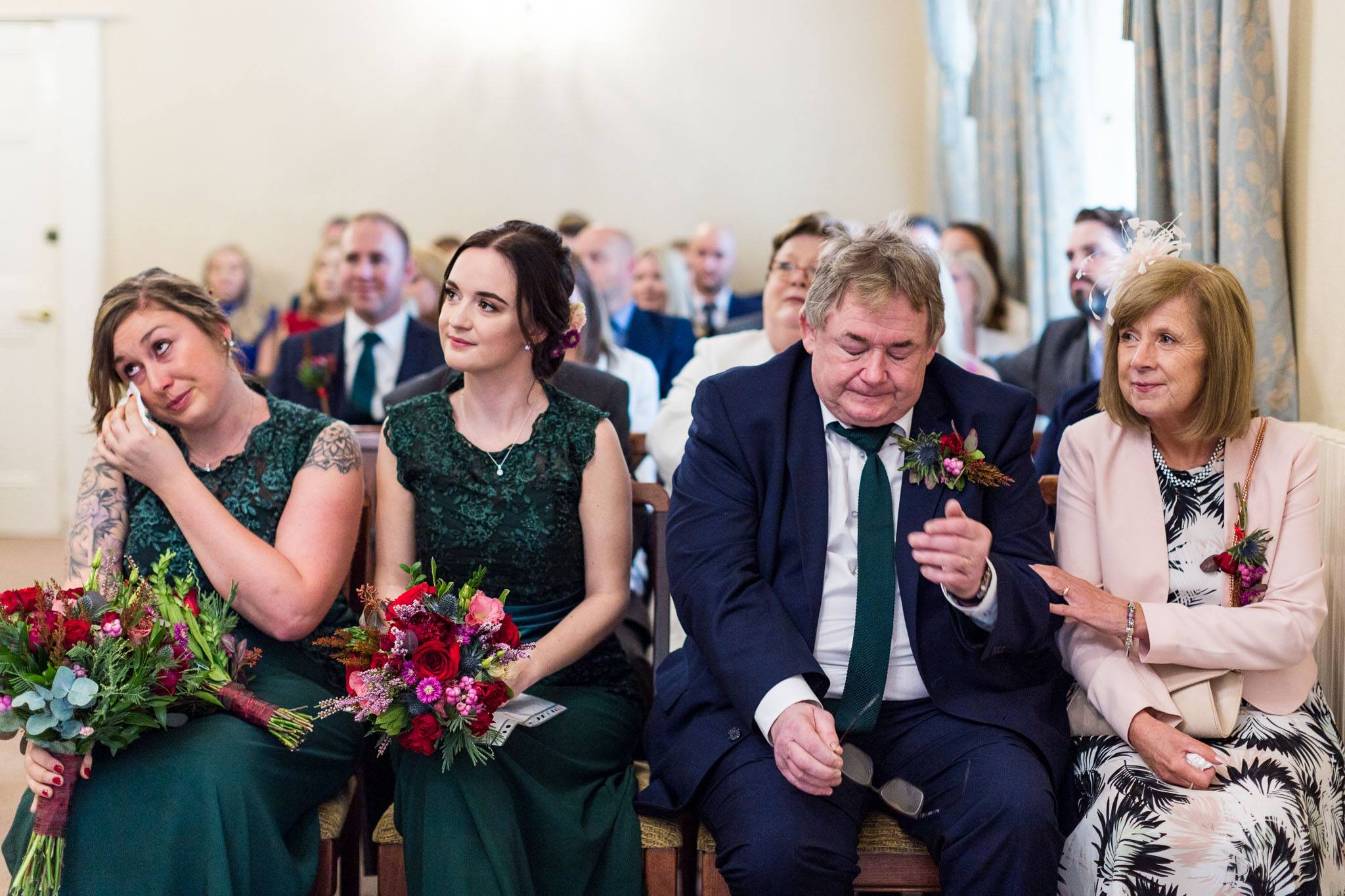 Emotional bridesmaid and father of the groom during wedding ceremony at The Tetley