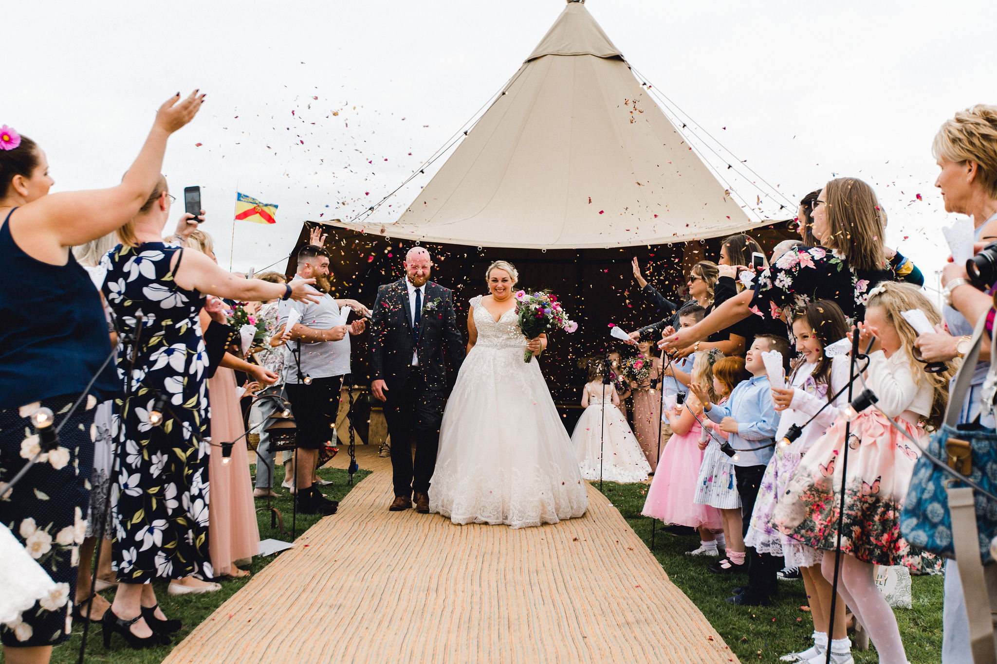 Confetti toss photo at a tipi wedding in Blackpool