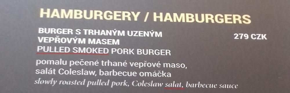 My translation: SMOKEY PULLED PORK BURGER slow roasted pulled pork, coleslaw, barbecue sauce